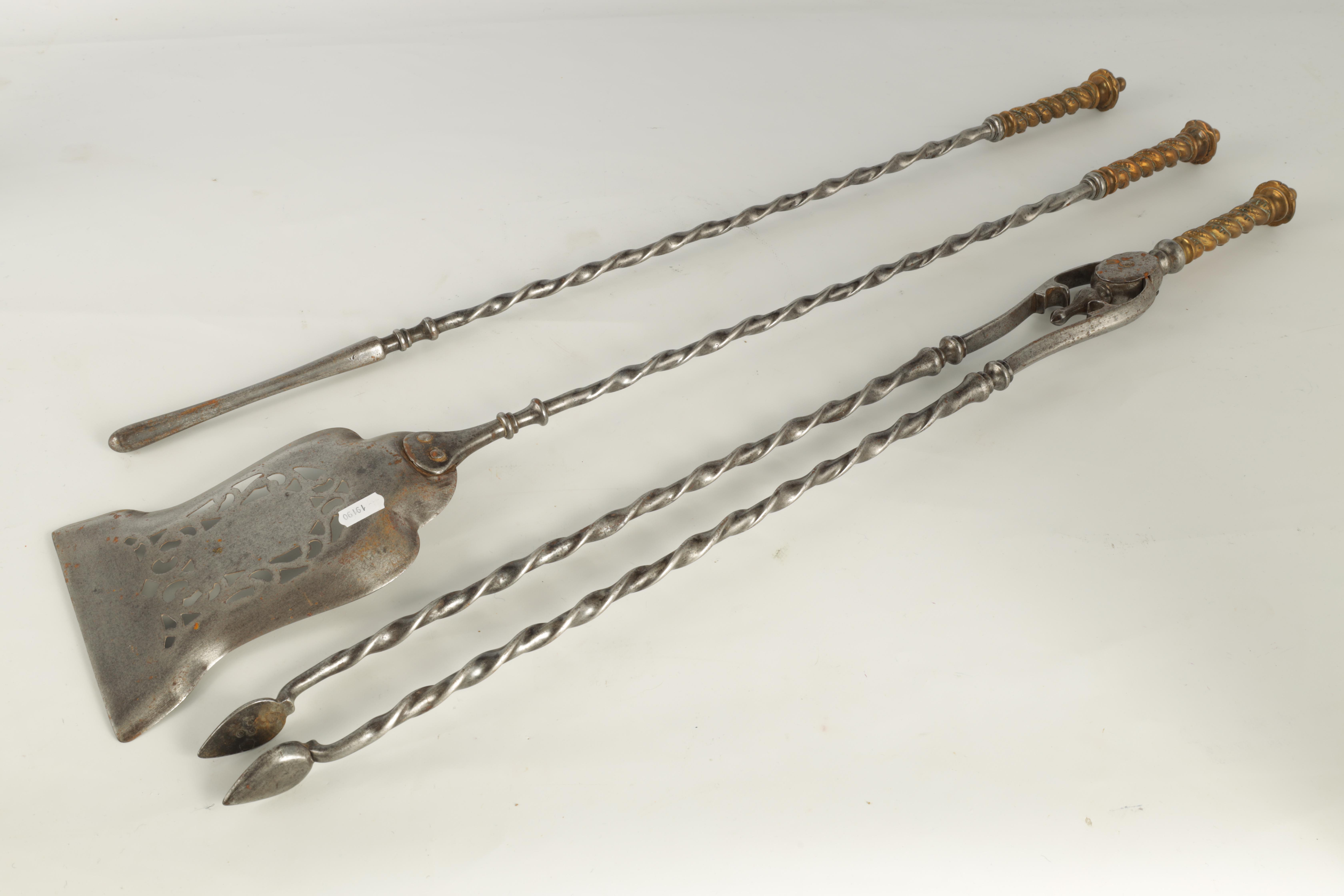 A SET OF REGENCY STEEL AND BRASS FIRE IRONS with cast brass handles and barley twist stems, the - Image 7 of 9