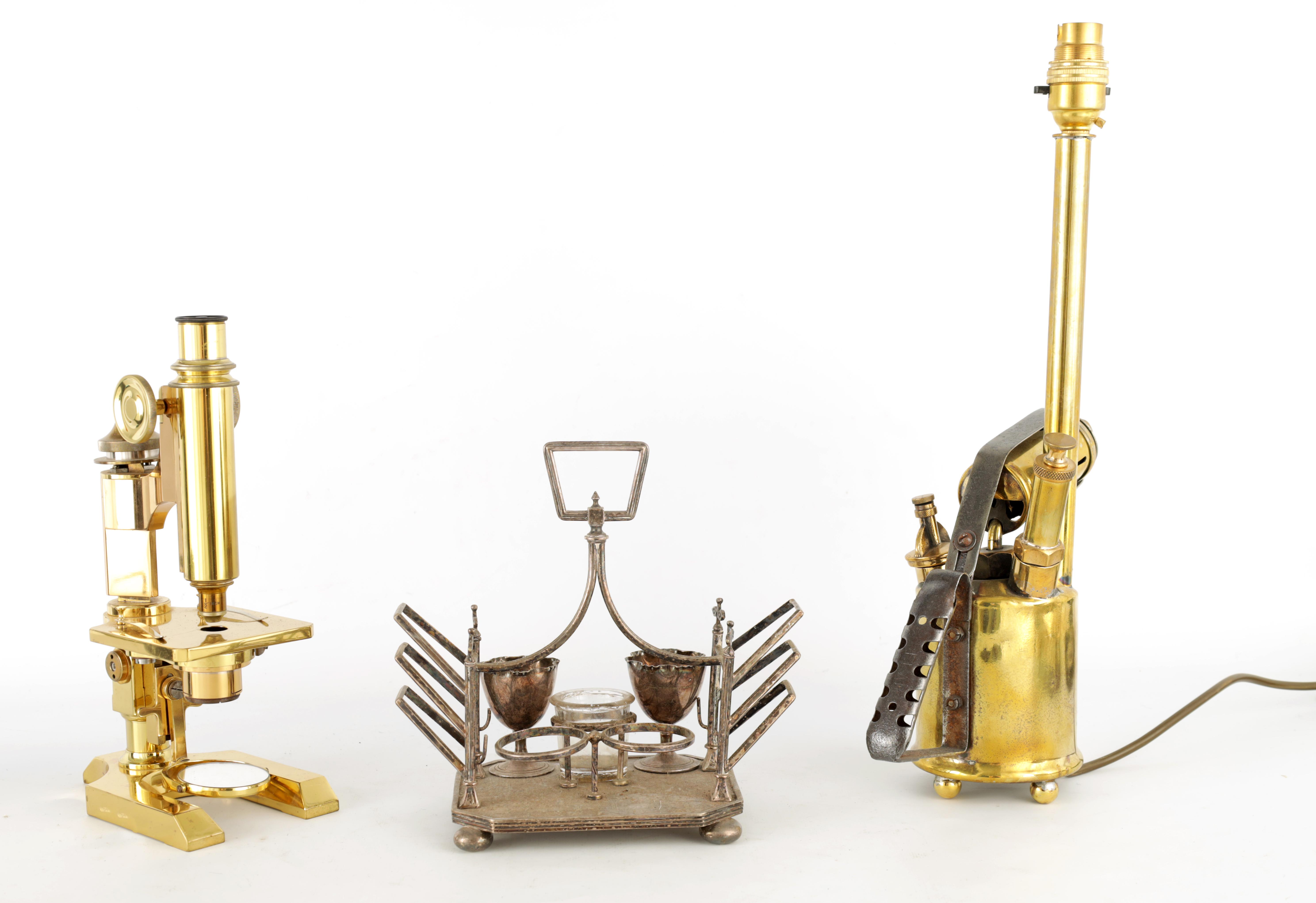 A 19TH CENTURY LACQUERED BRASS MONOCULAR MICROSCOPE with shaped base and rack and pinion focusing