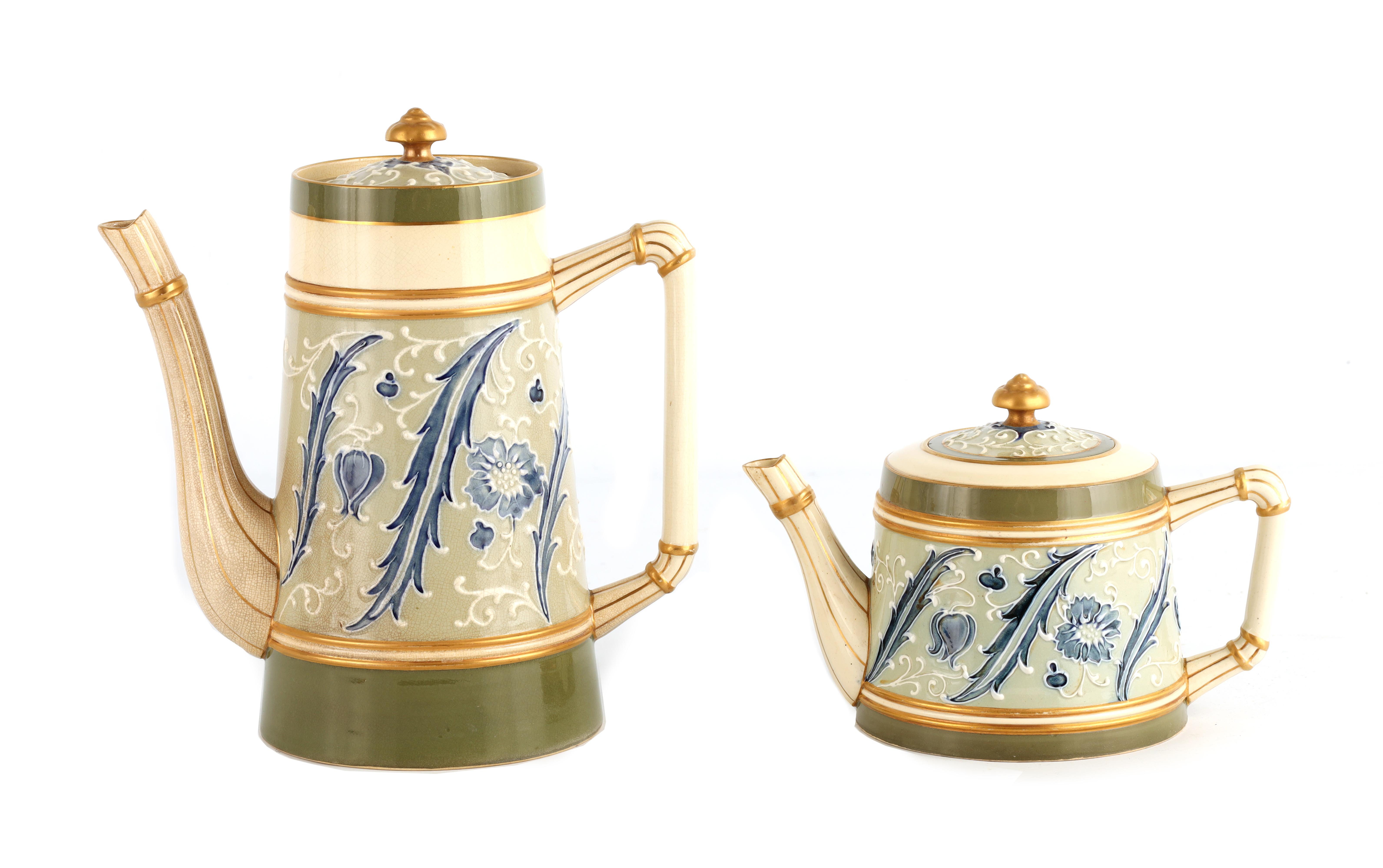 AN EARLY MACINTYRE BURSLEM TAPERING COFFEE POT AND MATCHING TEAPOT decorated in the Sicilian
