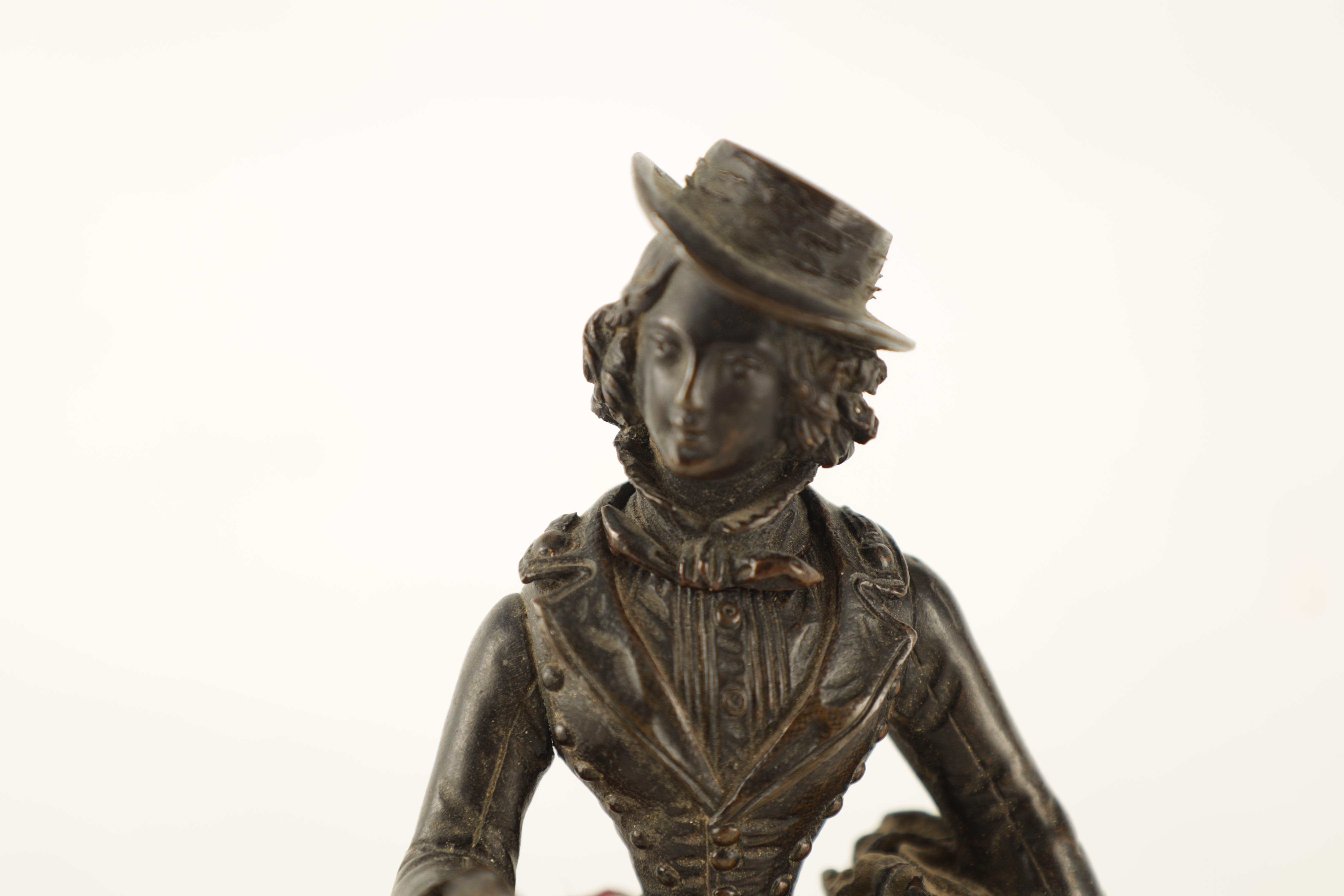 A LATE 19TH CENTURY NOVELTY BRONZE DESK COMPENDIUM DEPICTING A LADY HOLDING A RIFFLE with red - Image 2 of 10