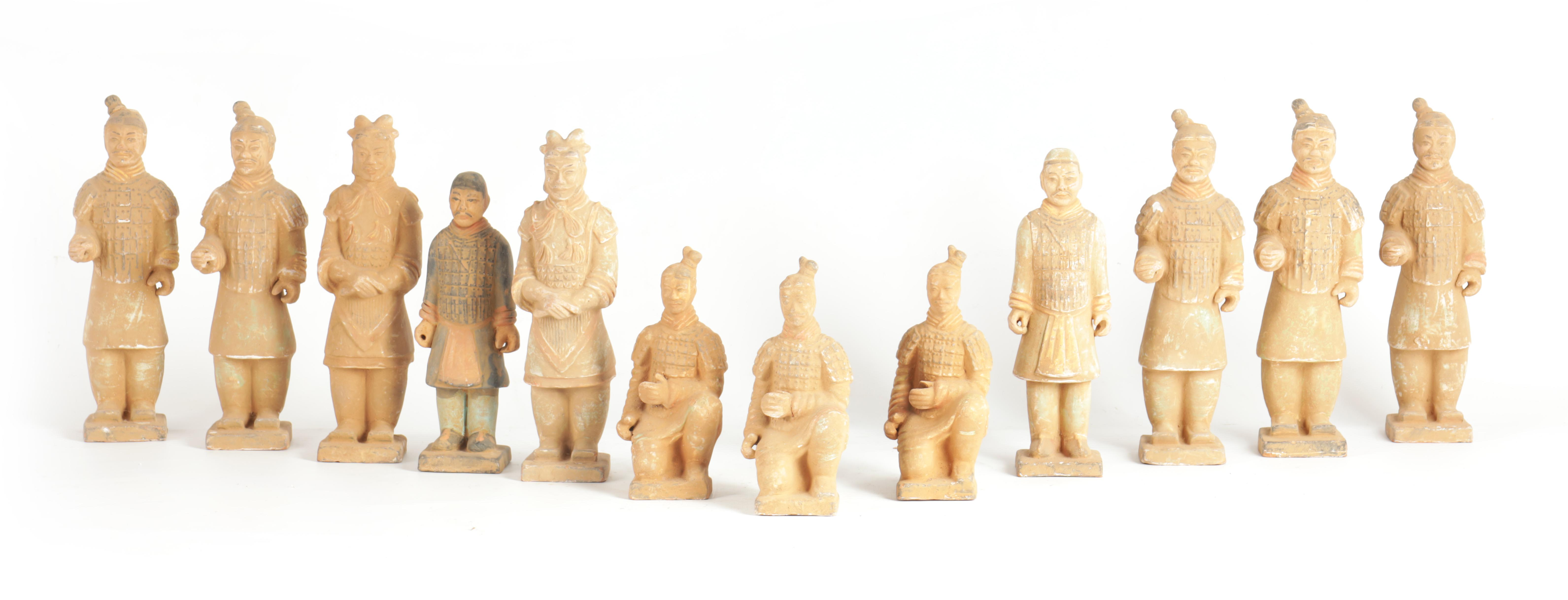 A SET OF 12 20TH CENTURY CHINESE FIGURES MODELLED AS THE TERRACOTTA ARMY depicting soldiers in