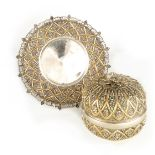 A 19TH CENTURY SILVER GILT LIDDED BOWL ON STAND with pierced rim and flowerhead decoration -