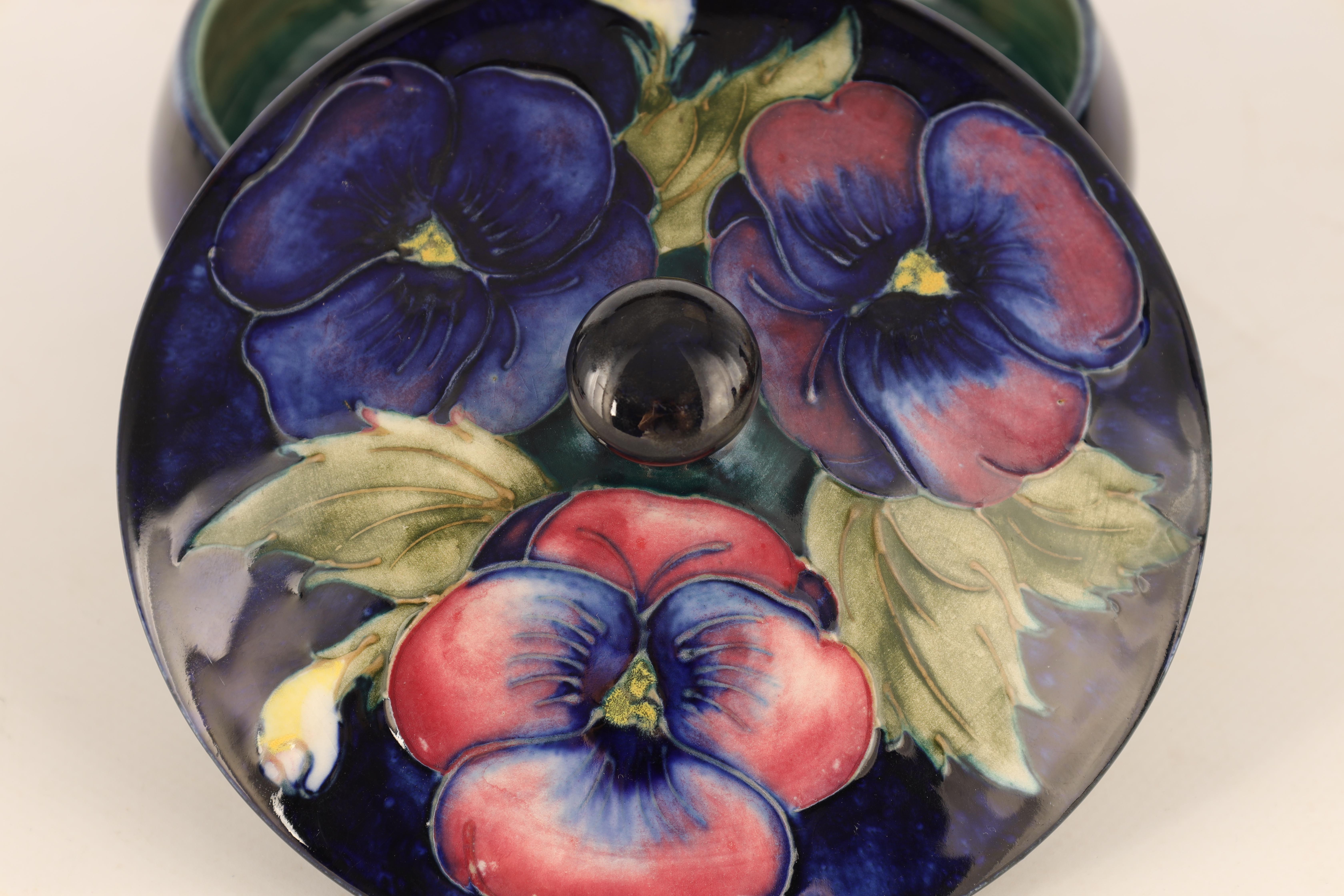 A MOORCROFT SHALLOW FOOTED BOWL AND COVER tube lined and decorated with leafing Pansy sprays on a - Image 6 of 6