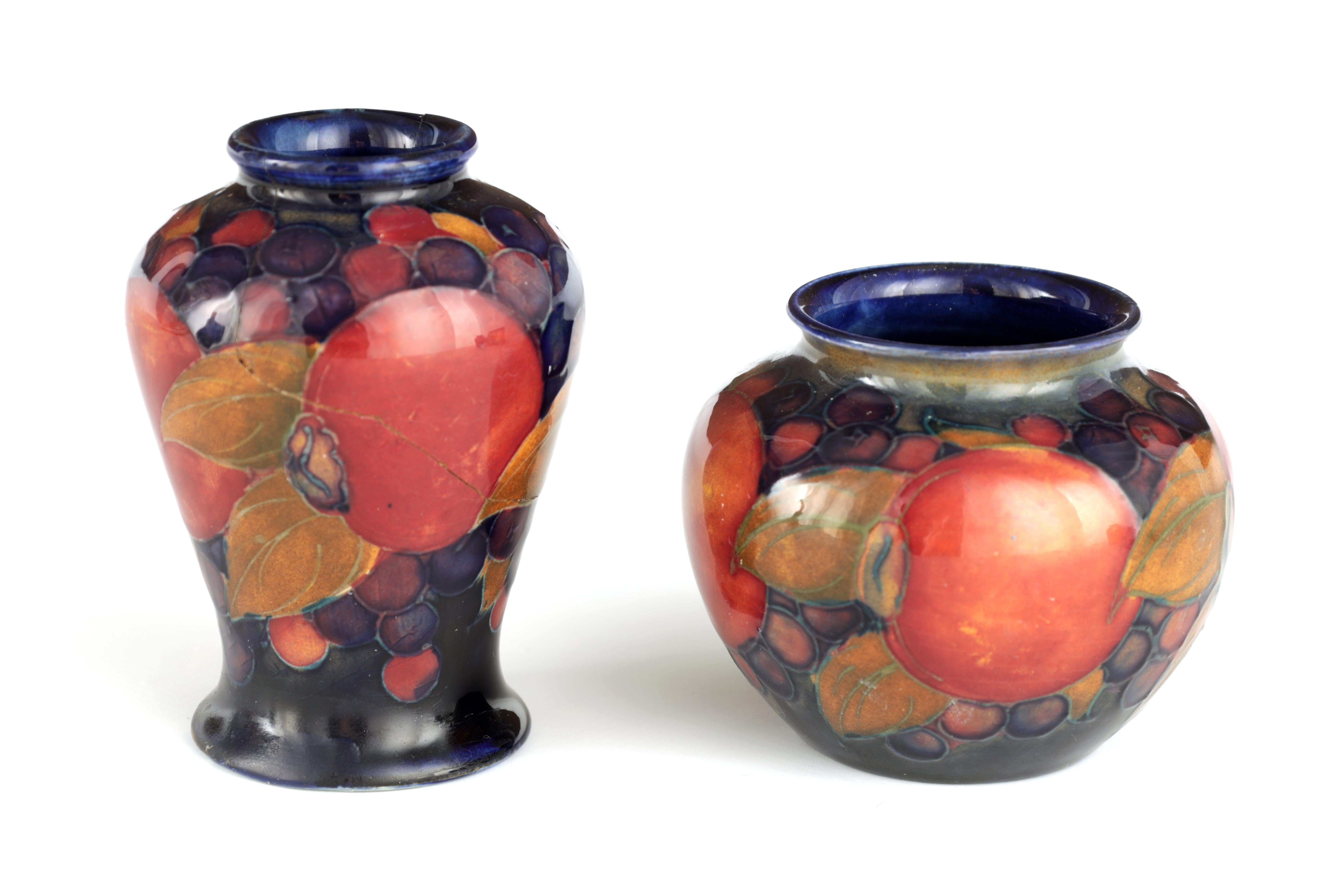 A 1920S MOORCROFT MINIATURE SQUAT BULBOUS VASE tube lined and decorated in the Pomegranate pattern