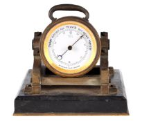 A LATE 19TH CENTURY NOVELTY PATINATED BRONZE AND MARBLE DESK BAROMETER modelled as a cannon standing
