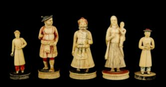 FIVE 19TH CENTURY INDIAN IVORY CHESS PIECES depicting finely carved figures in ceremonial dress