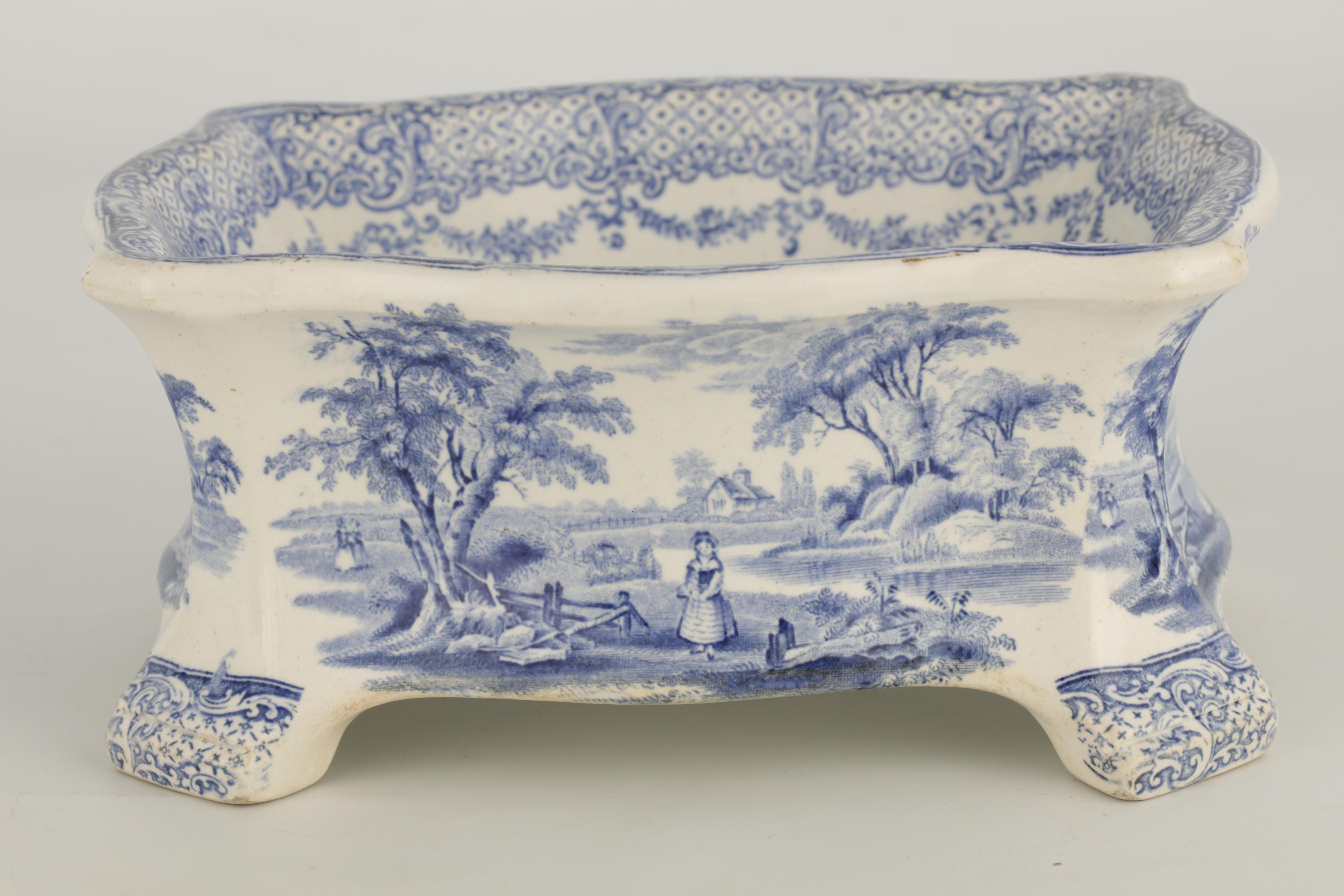 A RARE 19TH CENTURY RIDGWAY BLUE AND WHITE POTTERY DOG BOWL decorated with landscape scenes - Image 6 of 7