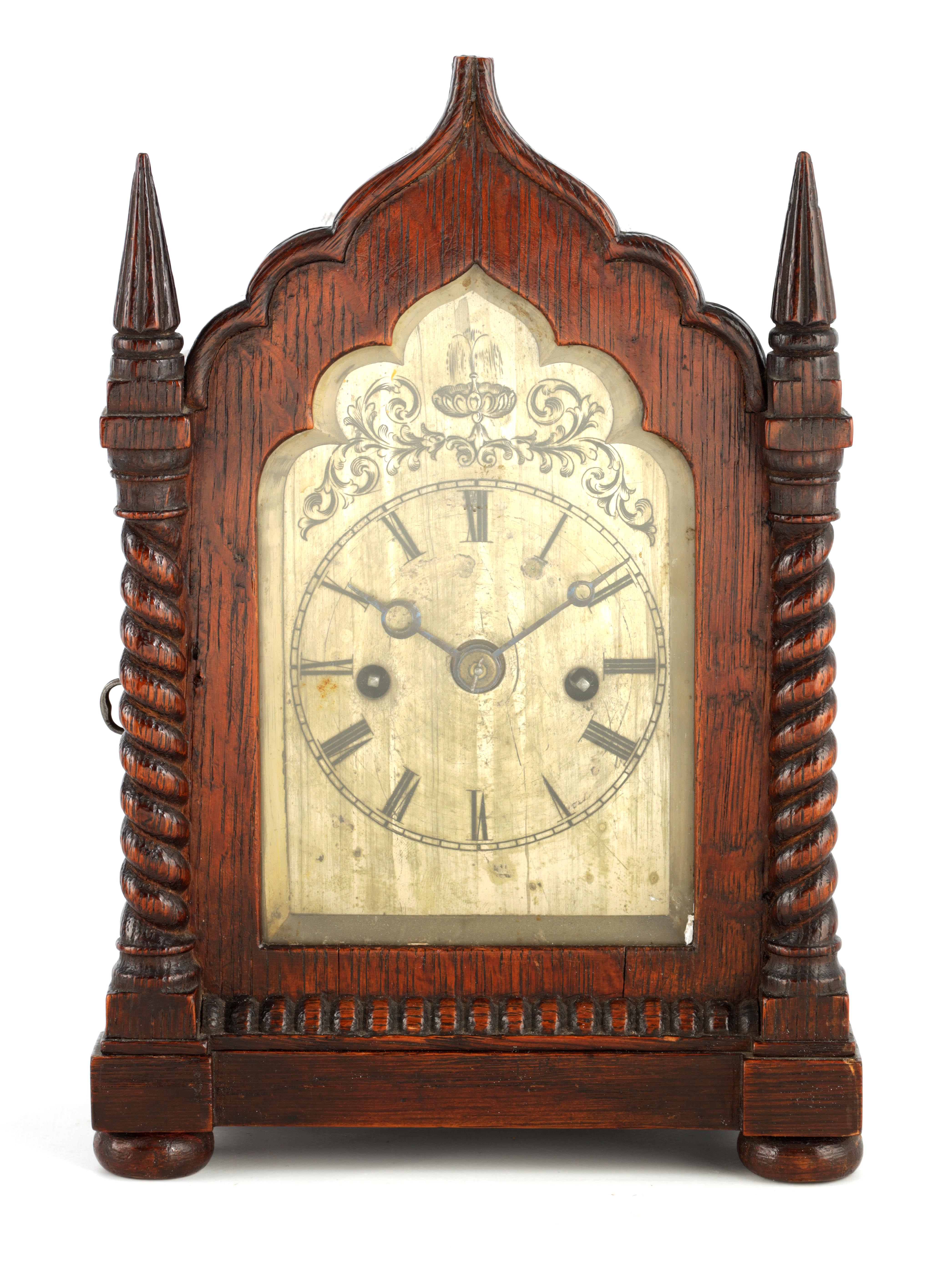 A SMALL MID 19TH CENTURY OAK CASED DOUBLE FUSEE MANTEL CLOCK the gothic style case with twisted