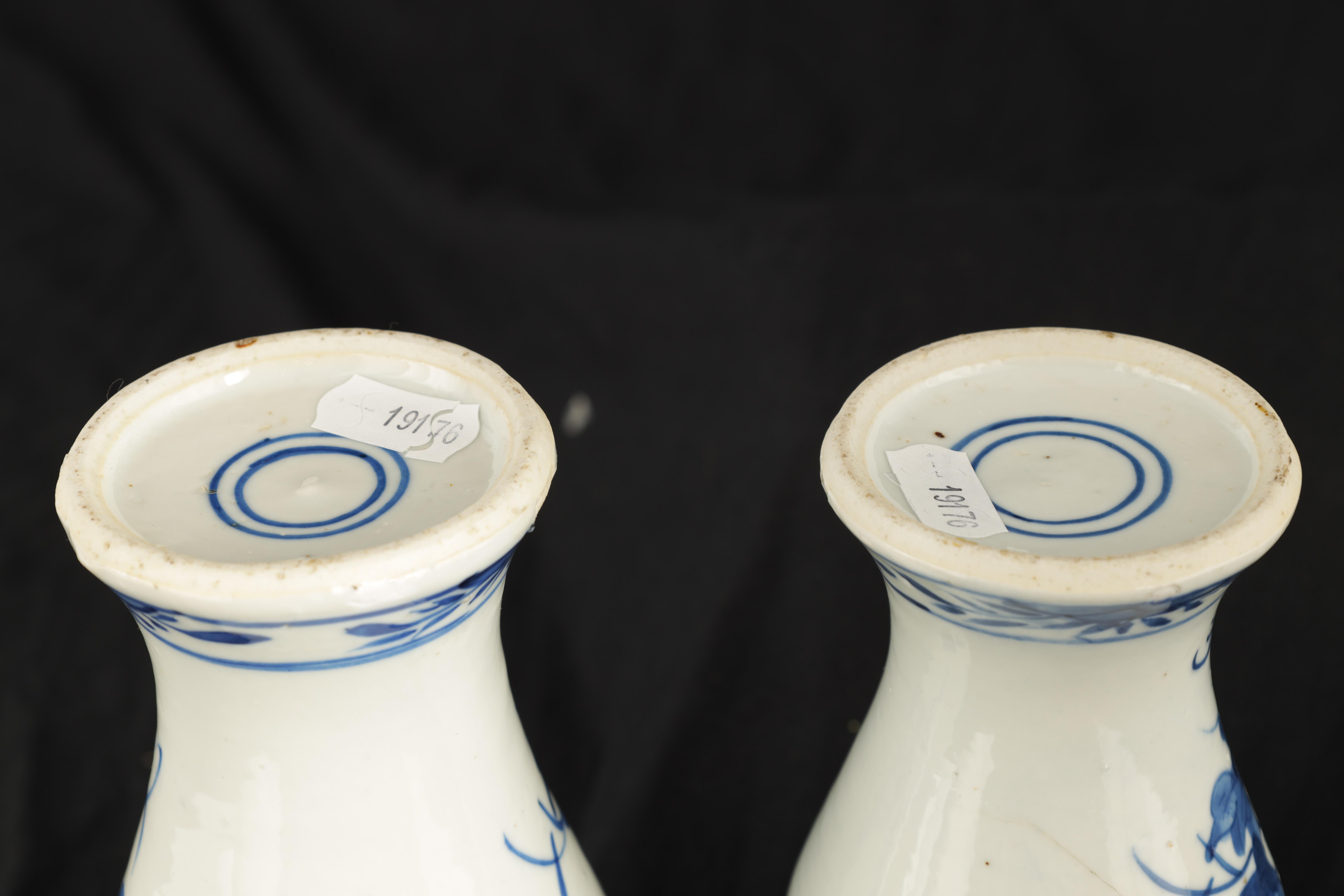 A PAIR OF 19TH CENTURY CHINESE BLUE AND WHITE VASES decorated with blossoming trees and birds 17cm - Image 8 of 9