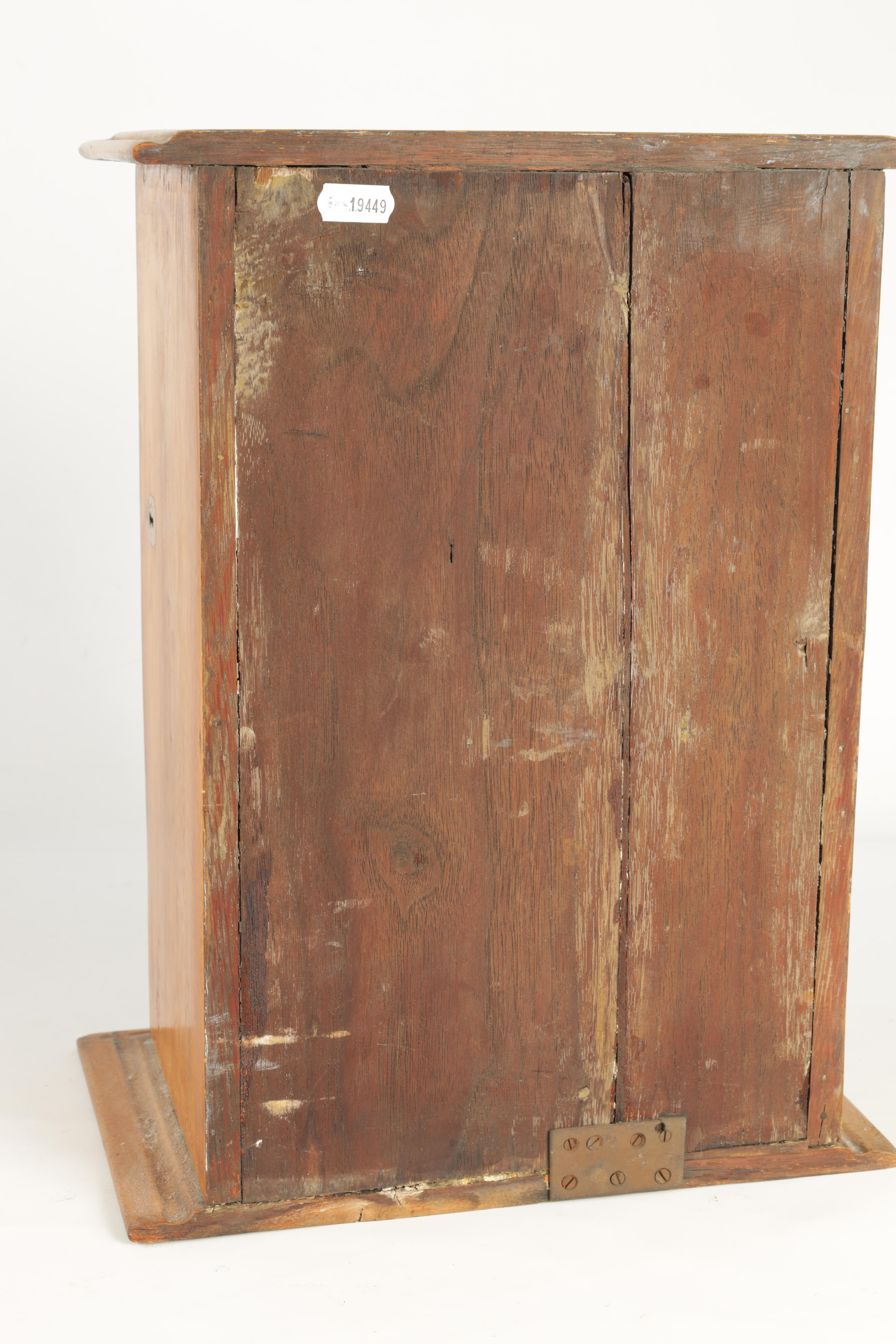 A STYLISH EDWARDIAN OAK SMOKERS CABINET with glazed door enclosing a shelved three drawer interior - Image 11 of 11