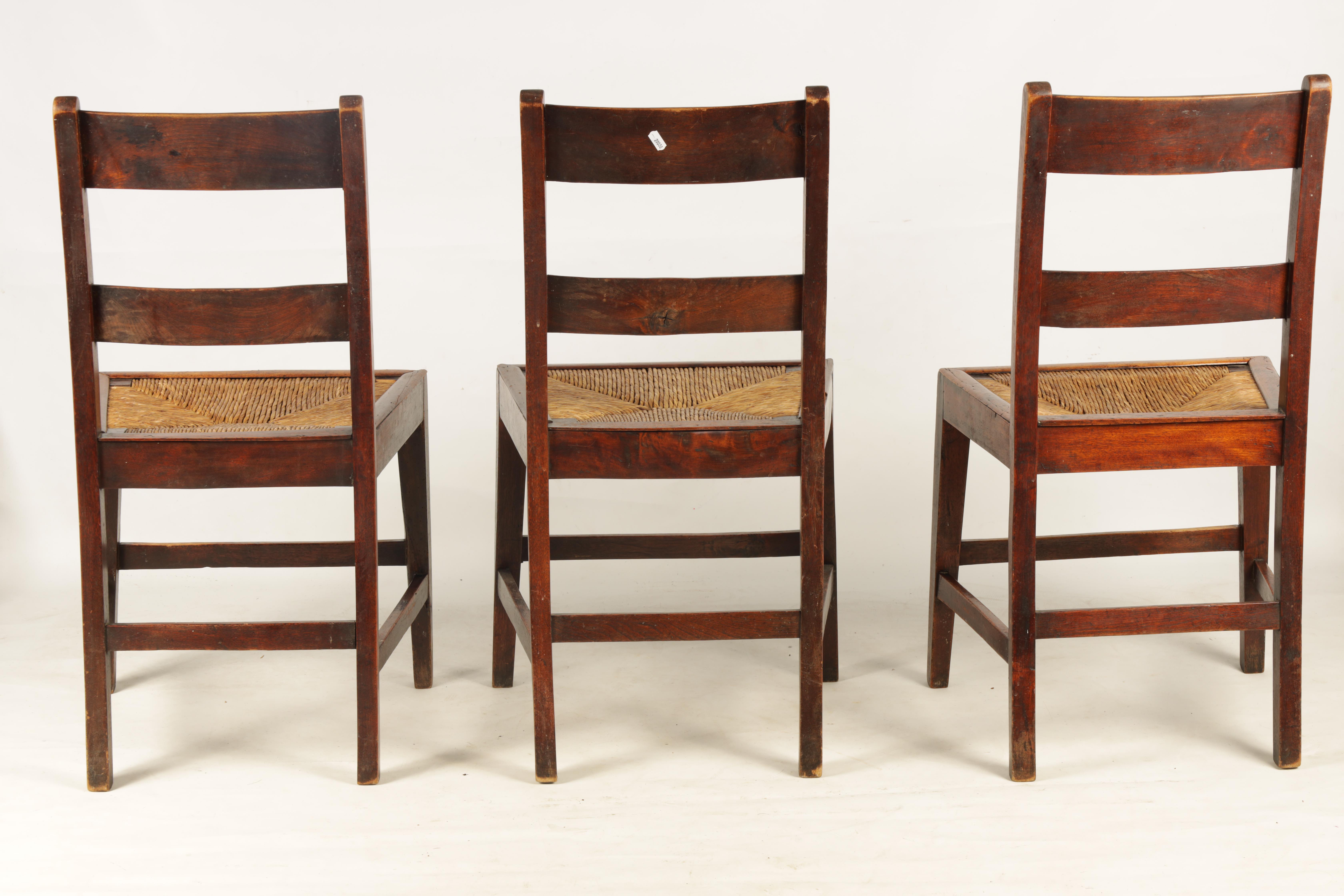 A SET OF SIX 19TH CENTURY COUNTRY FRUITWOOD DINING CHAIRS with rush seats and bar backs; standing on - Image 5 of 9