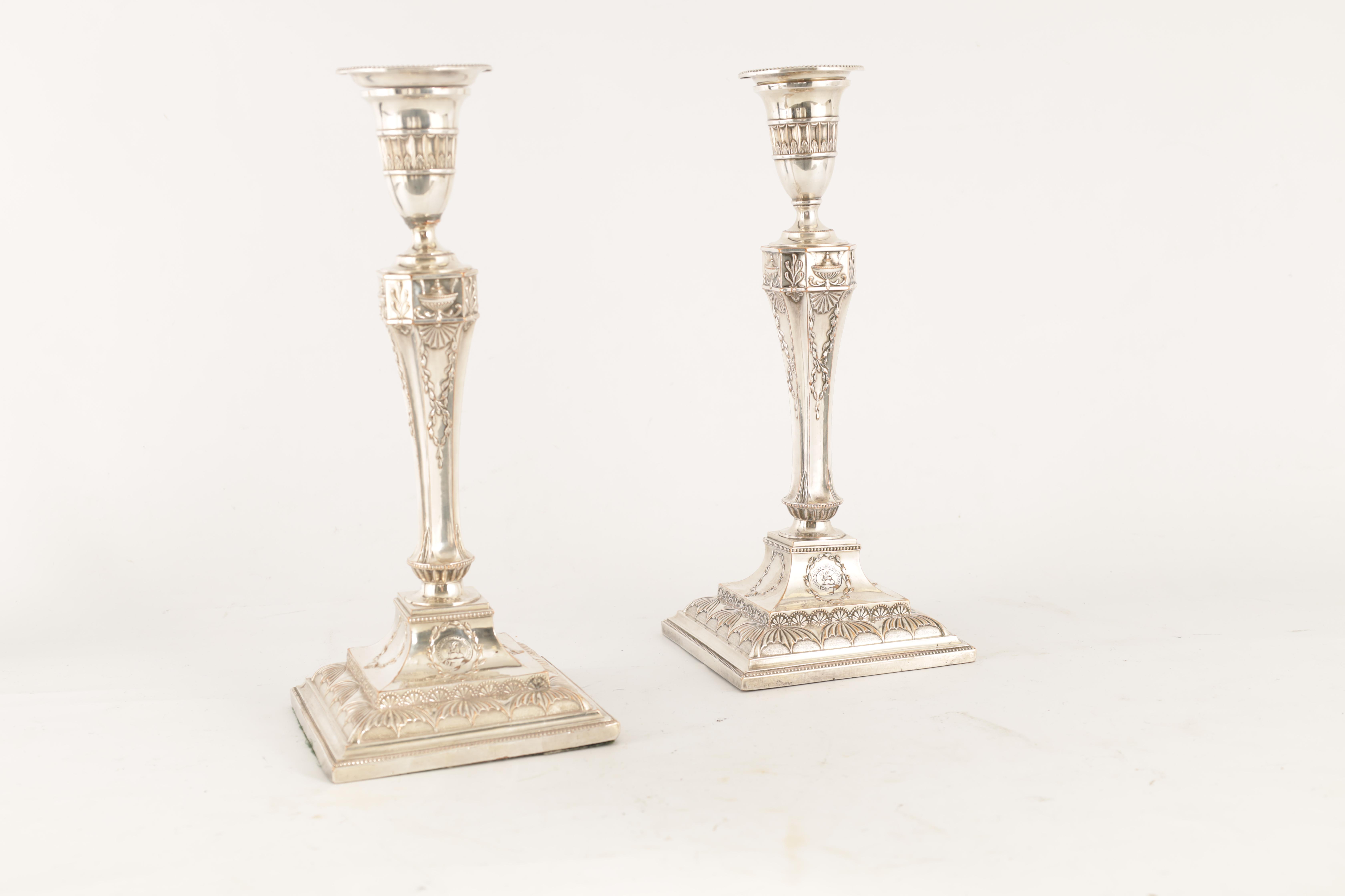 A PAIR OF 19TH CENTURY SHEFFIELD PLATE SILVER ON COPPER ADAM STYLE CANDLESTICKS bearing the crest - Image 2 of 5