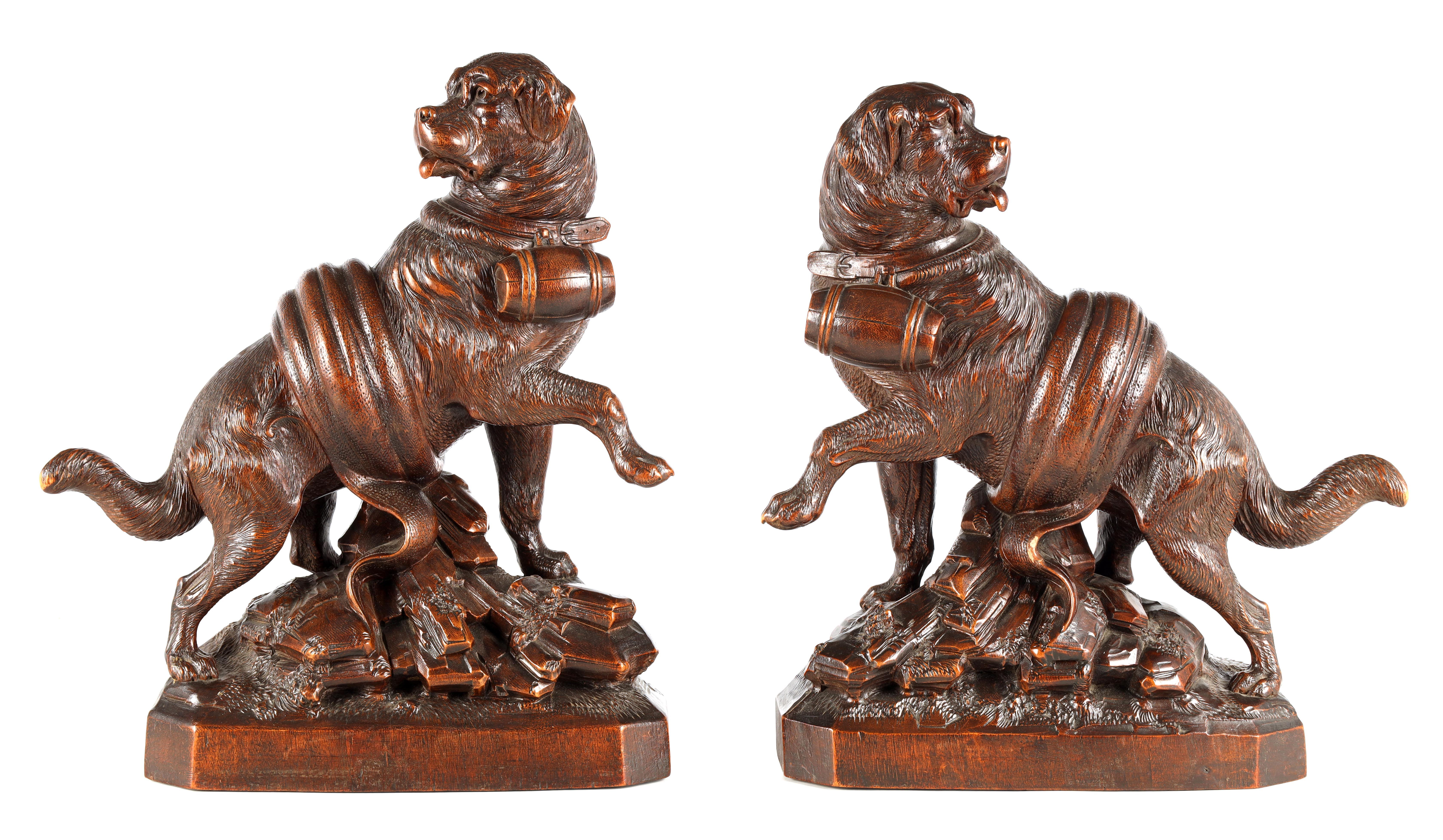 A GOOD QUALITY PAIR OF LATE 19TH CENTURY BLACK FOREST CARVED SCULPTURES modelled as Saint Bernards