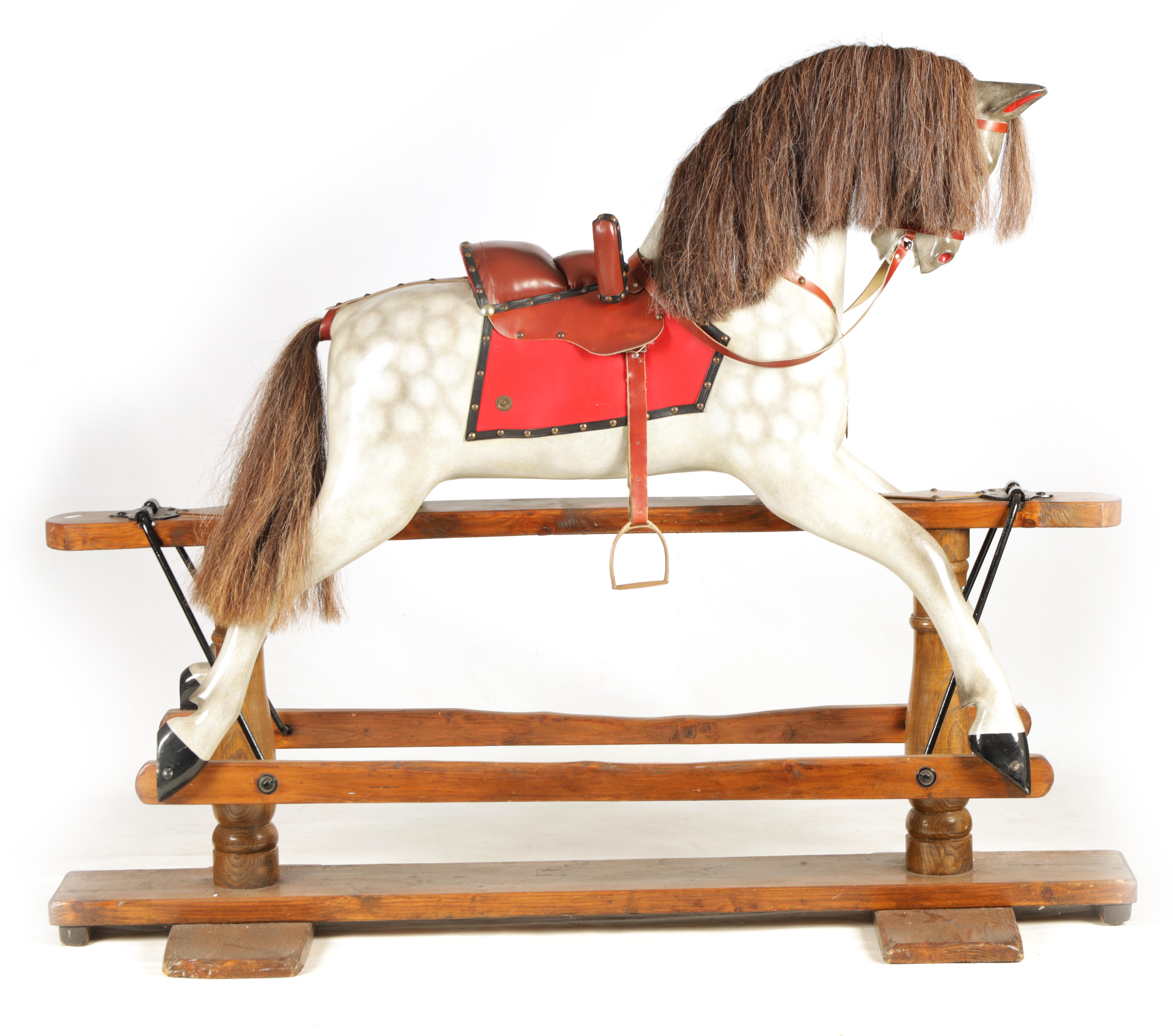 A LARGE 20TH CENTURY DAPPLE GREY PAINTED WOOD ROCKING HORSE with leather seat and bridle 157cm