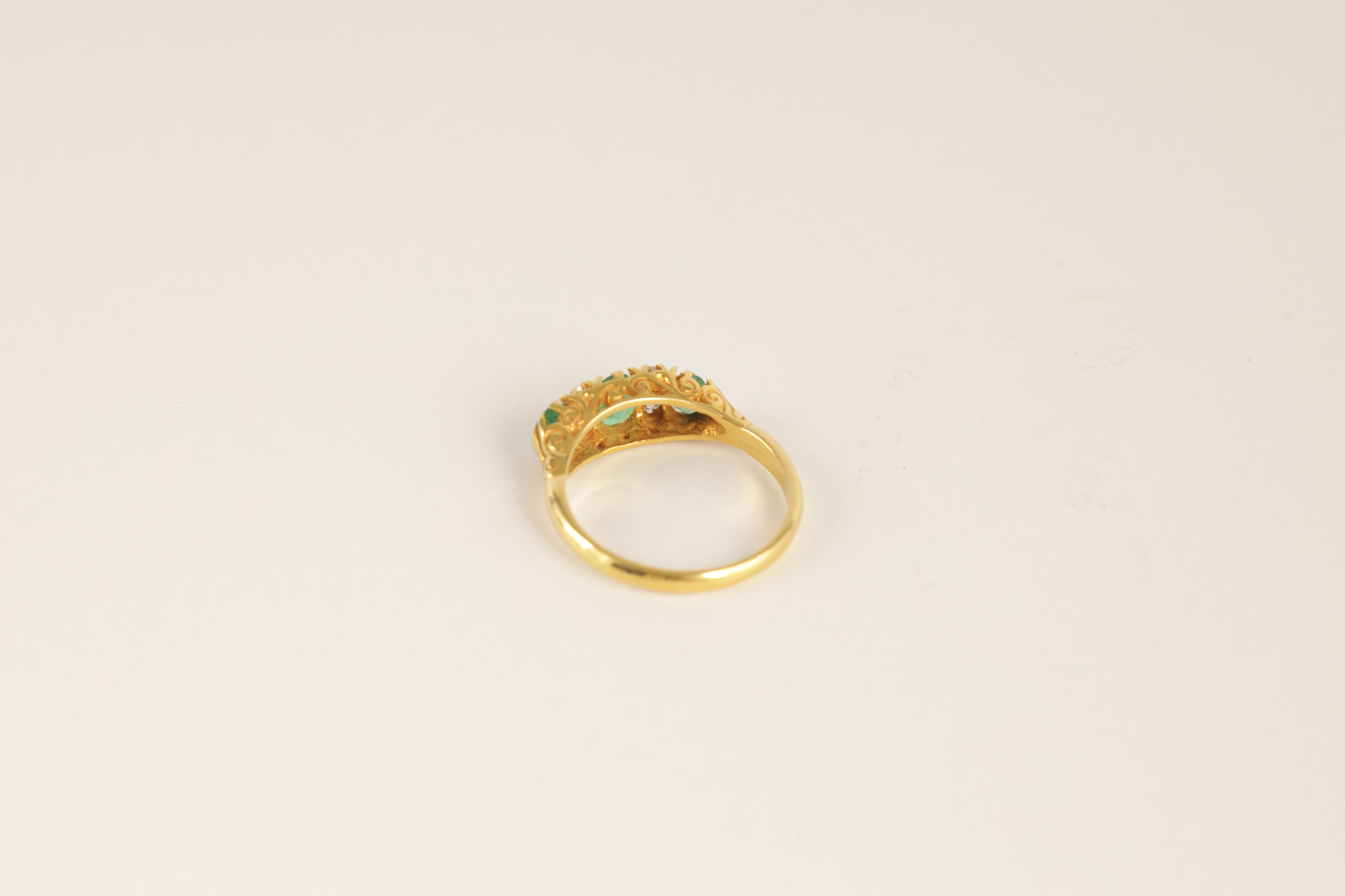 A LADIES 18CT GOLD DIAMOND AND EMERALD RING having four small diamonds set between three oval - Image 4 of 4