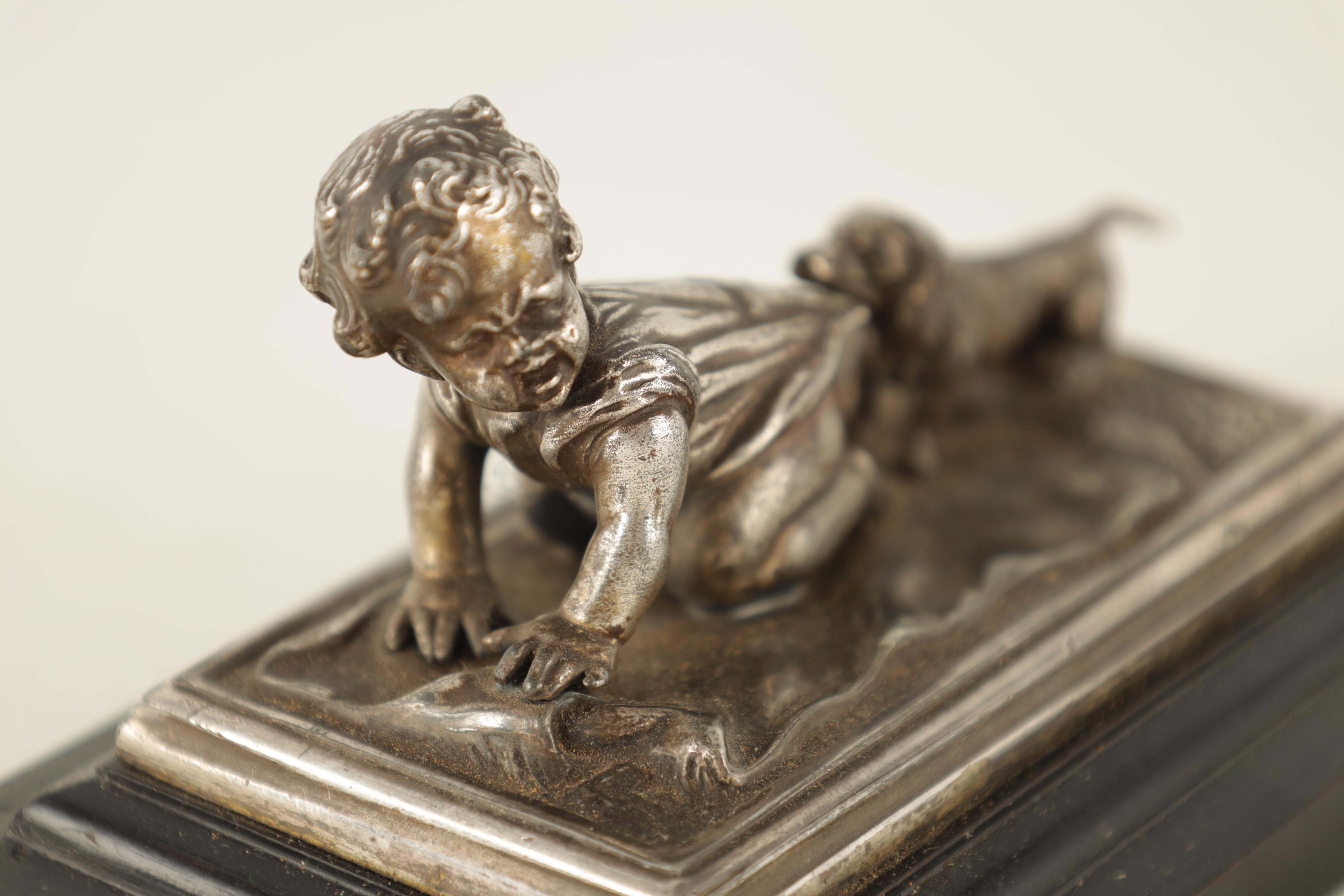 AN UNUSUAL 19TH CENTURY W.M.F. SILVERED METAL DESK PAPERWEIGHT depicting a small child with a - Image 3 of 5