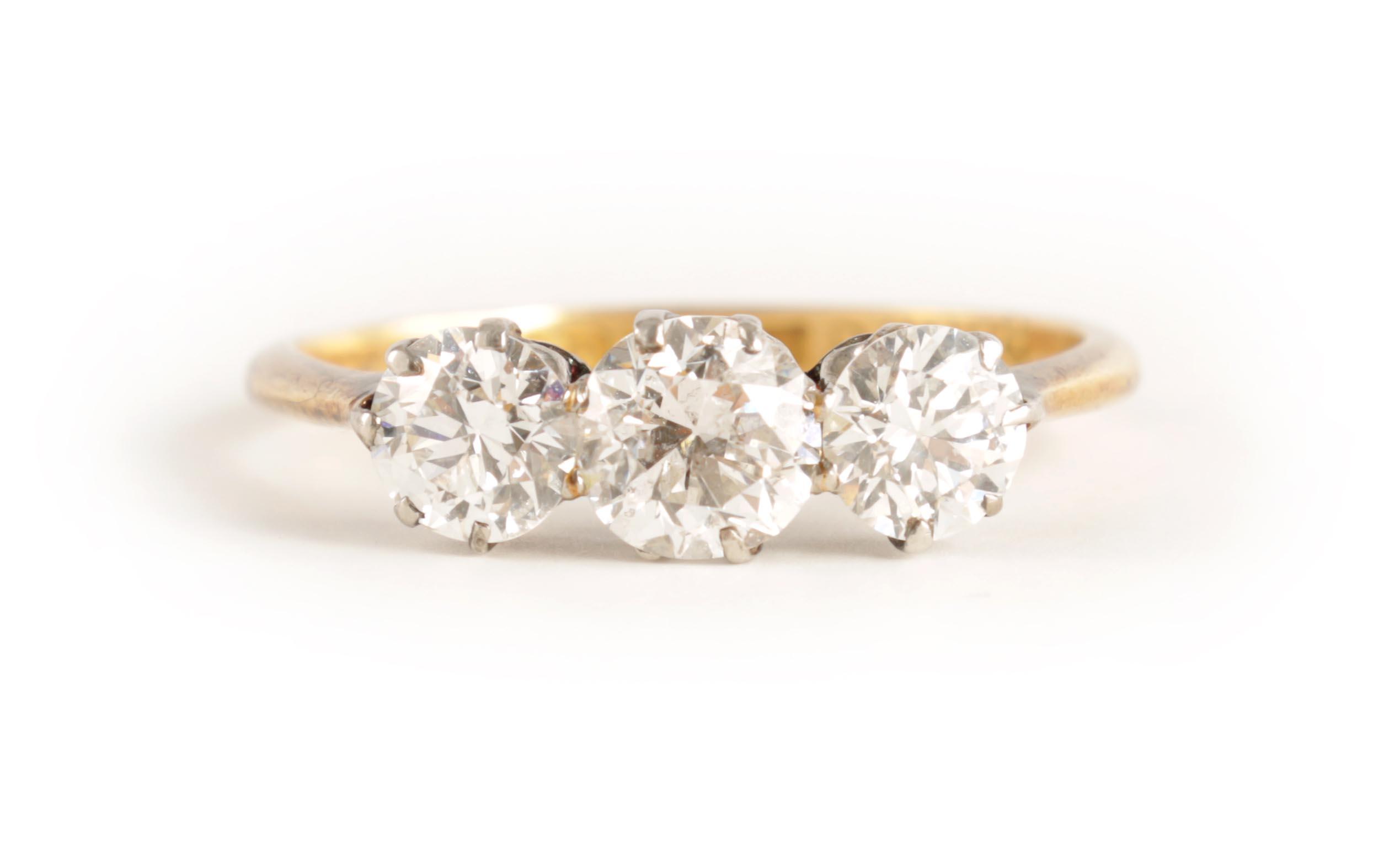 A LADIES THREE STONE DIAMOND RING on an 18ct gold shank, app. 1.2cts. of diamonds, clarity SI2,