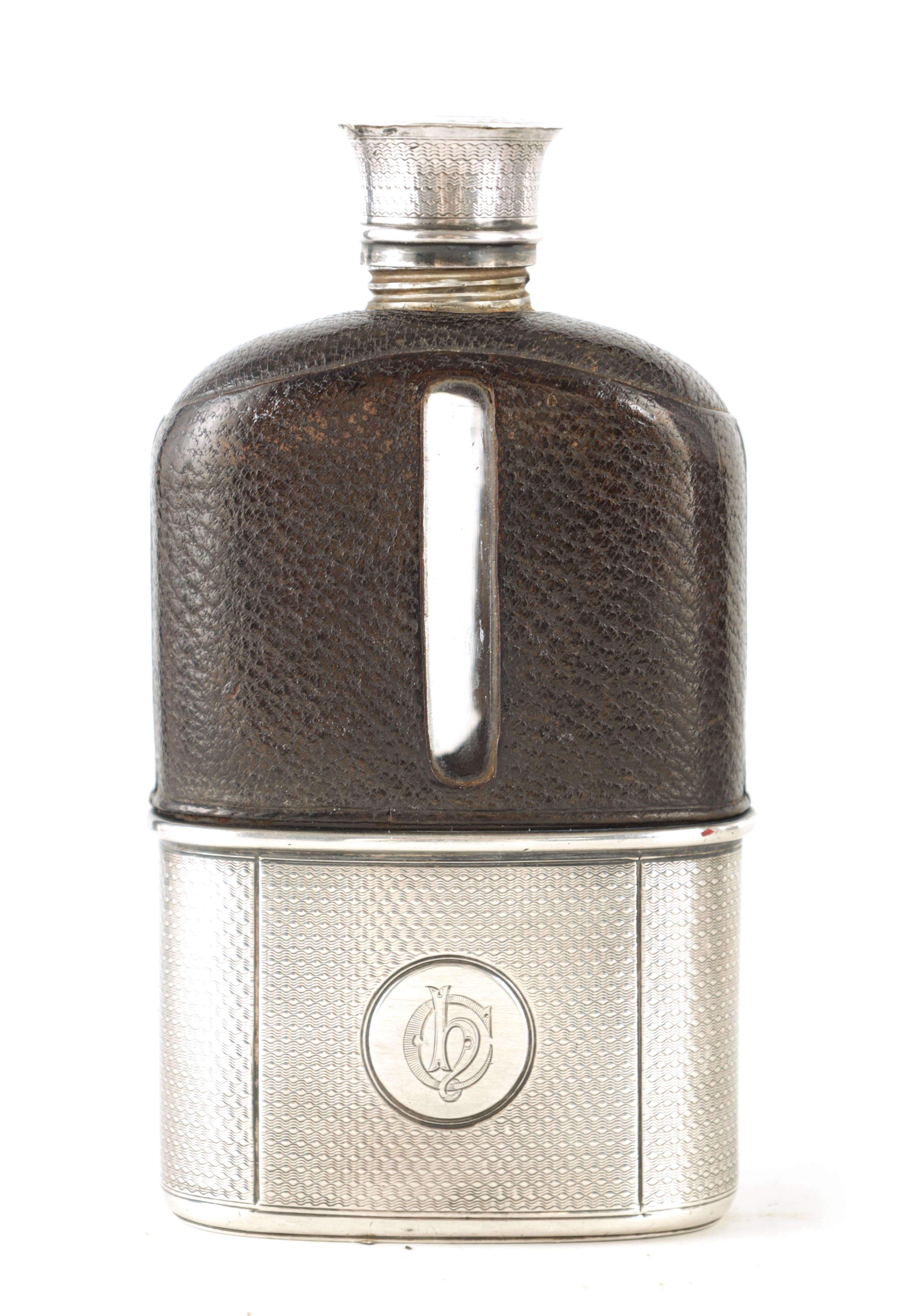 A VICTORIAN SILVER AND MOROCCAN LEATHER HIP FLASK RETAILED BY ASPREY 186 BOND STREET with engine-