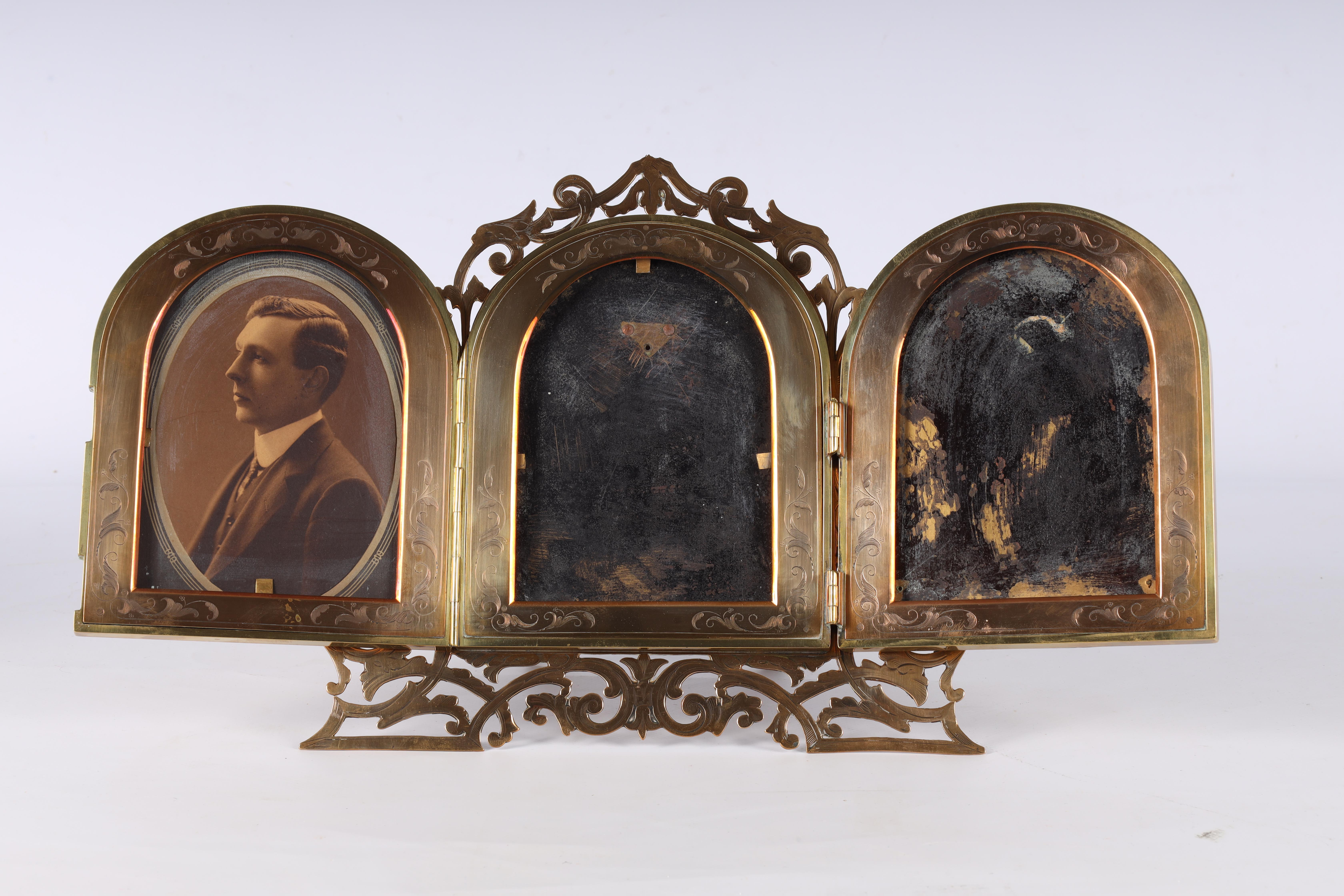 A LATE 19TH CENTURY PIERCED AND ENGRAVED BRONZE FOLDING PHOTOGRAPH FRAME the front with four - Image 3 of 8