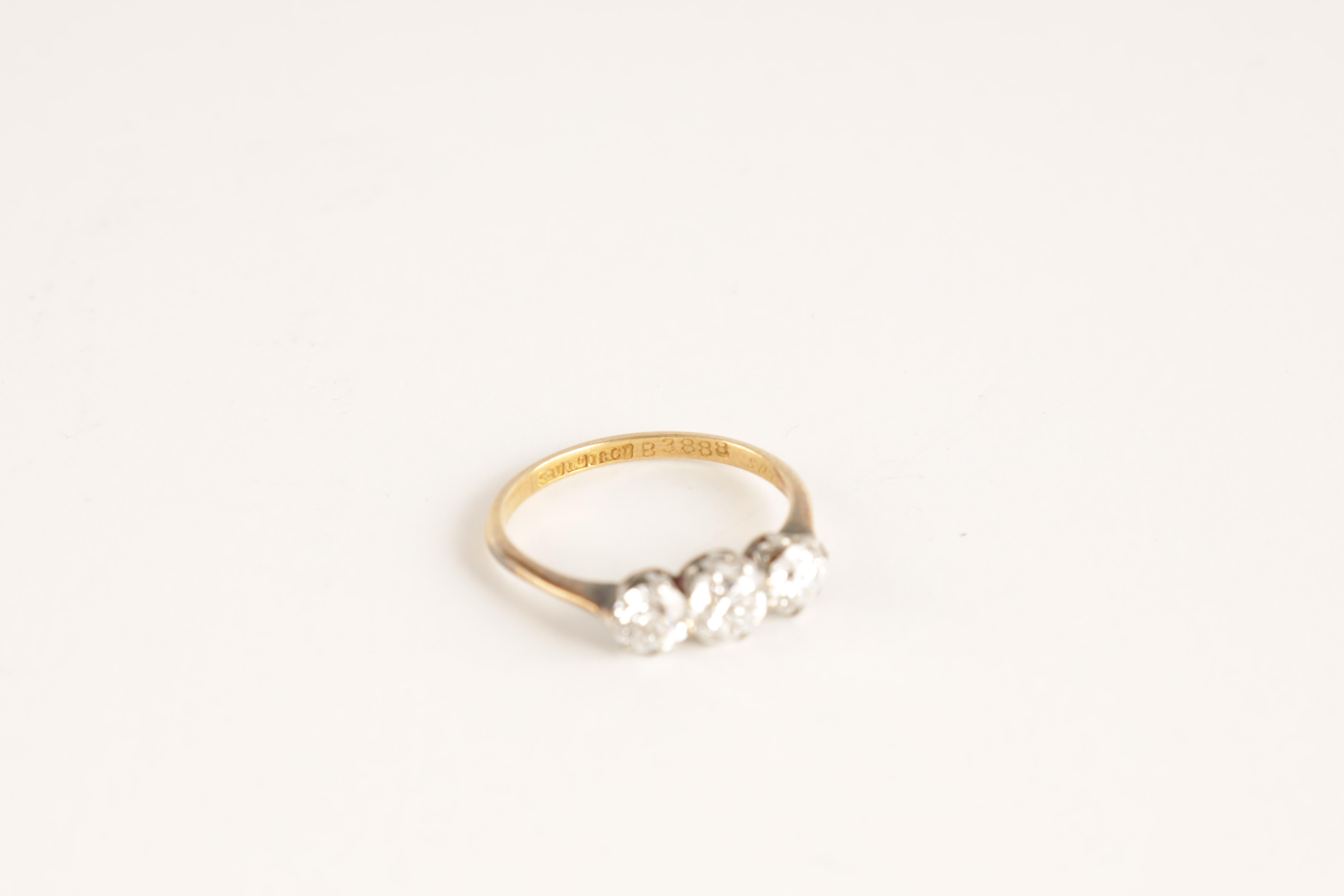 A LADIES THREE STONE DIAMOND RING on an 18ct gold shank, app. 1.2cts. of diamonds, clarity SI2, - Image 2 of 5