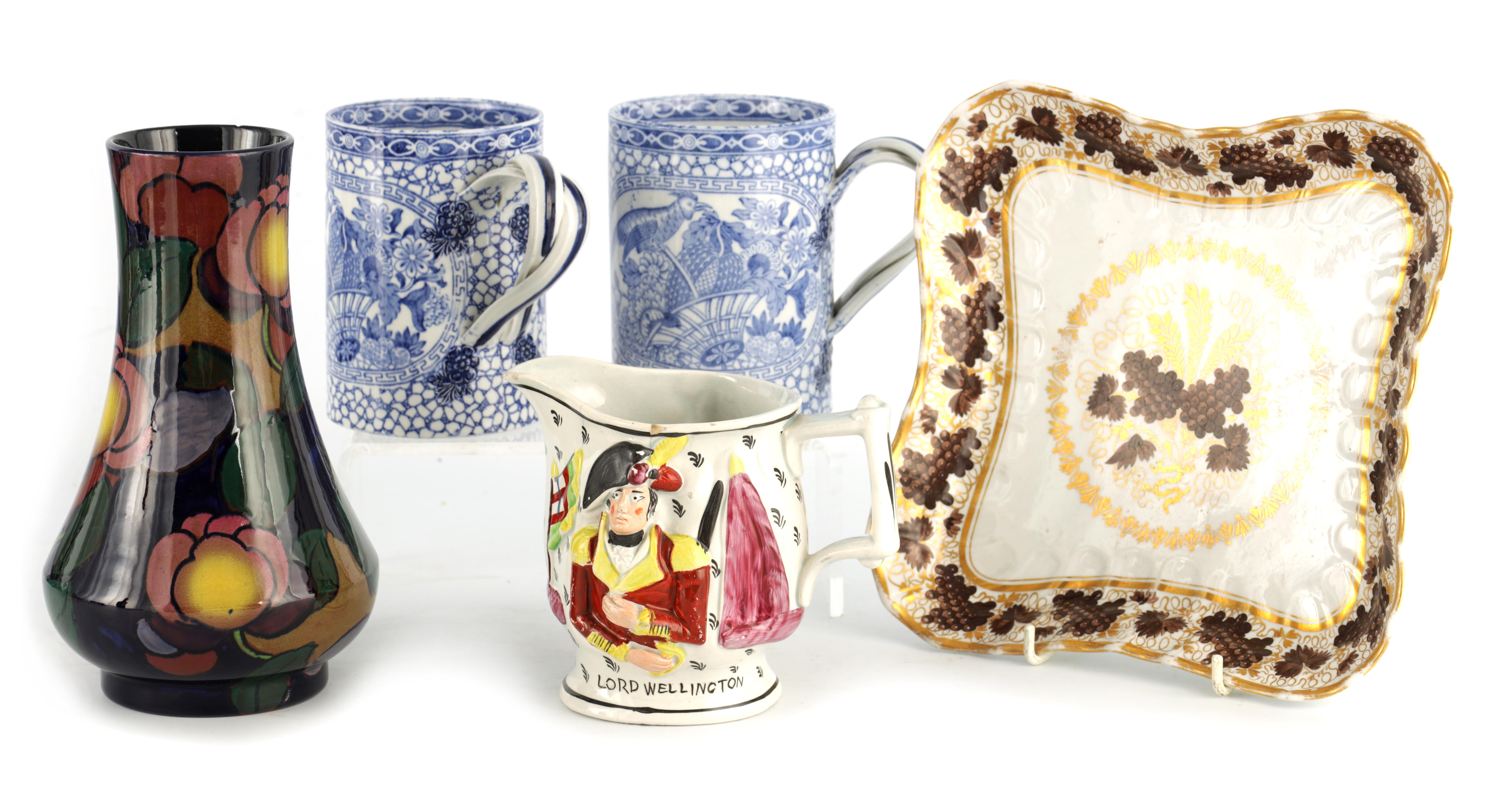 A 19TH CENTURY PEARLWARE JUG WITH RELIEF MOULDED PANELS OF LORD WELLINGTON AND GENERAL HILL on a