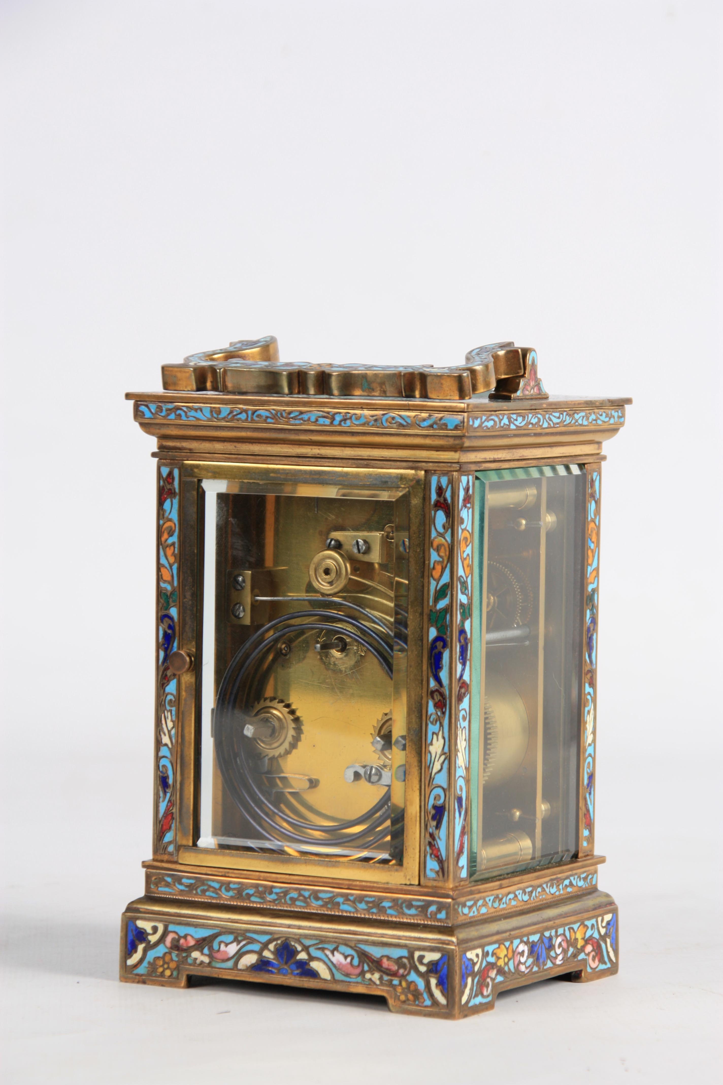A LATE 19TH CENTURY FRENCH CHAMPLEVE ENAMEL STRIKING CARRIAGE CLOCK the case covered in champleve - Image 4 of 6