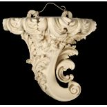 A FINE GEORGE III PAINTED CARVED MAHOGANY ROCOCO HANGING WALL BRACKET IN THE MANNER OF WILLIAM
