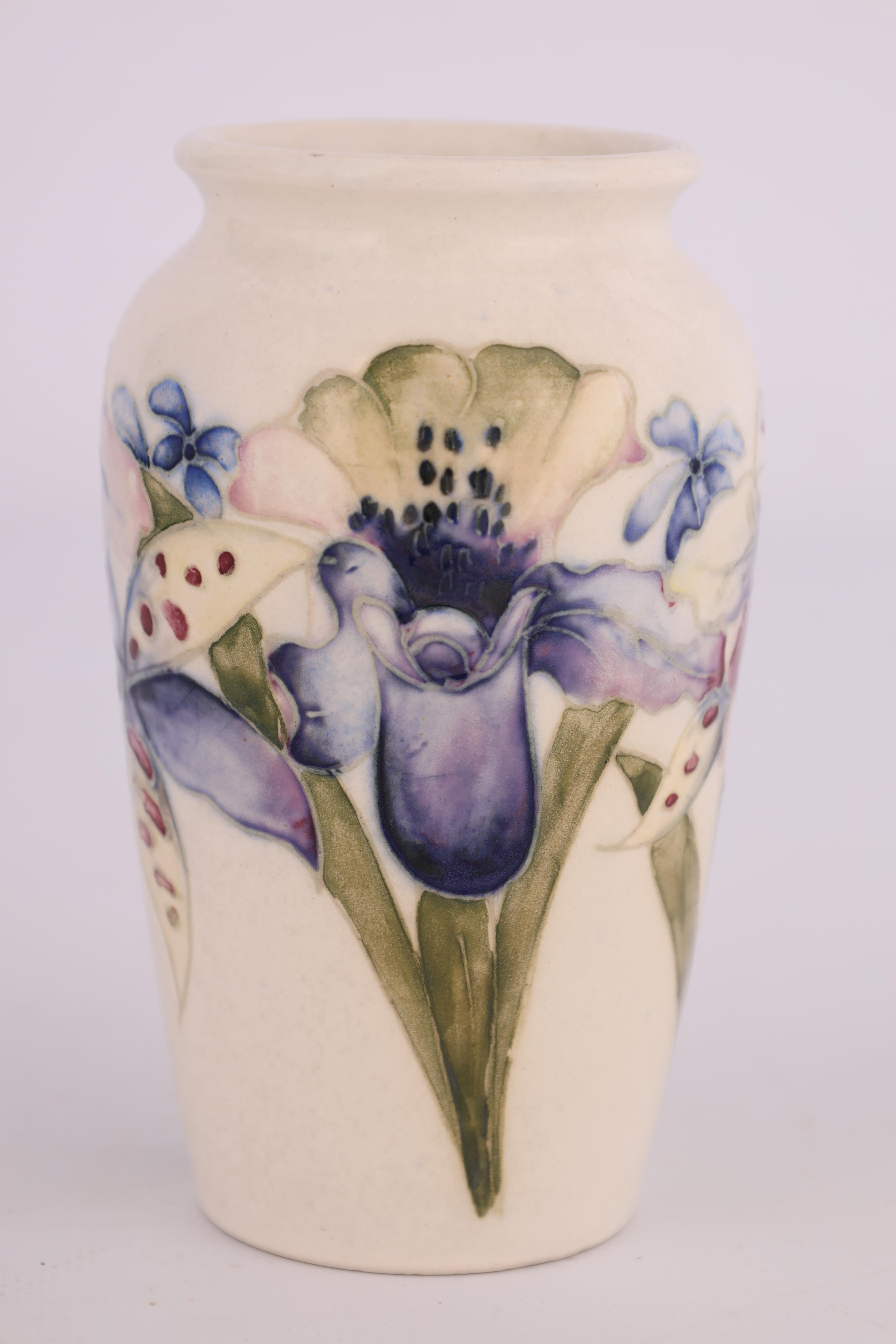 A MOORCROFT SMALL TAPERING SHOULDERED VASE decorated with orchid sprays on a cream ground, 13cm - Image 3 of 4