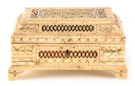 A LATE 18TH CENTURY RUSSIAN ENGRAVED BONE CASKET having pierced panels and green, red, and blue