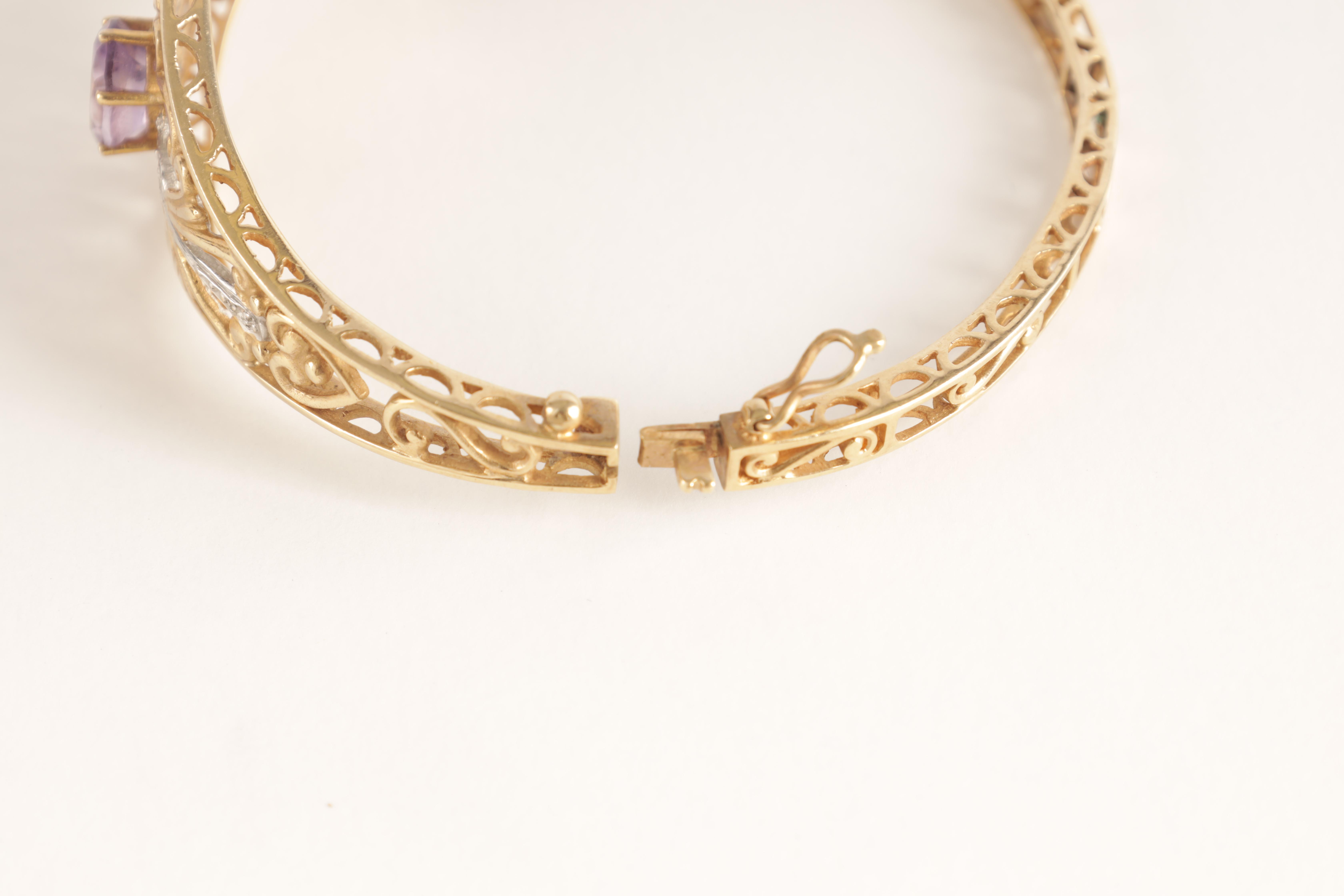 A LADIES 9CT GOLD DIAMOND AND AMETHYST BANGLE having filigree scrollwork decoration with diamonds - Image 4 of 4