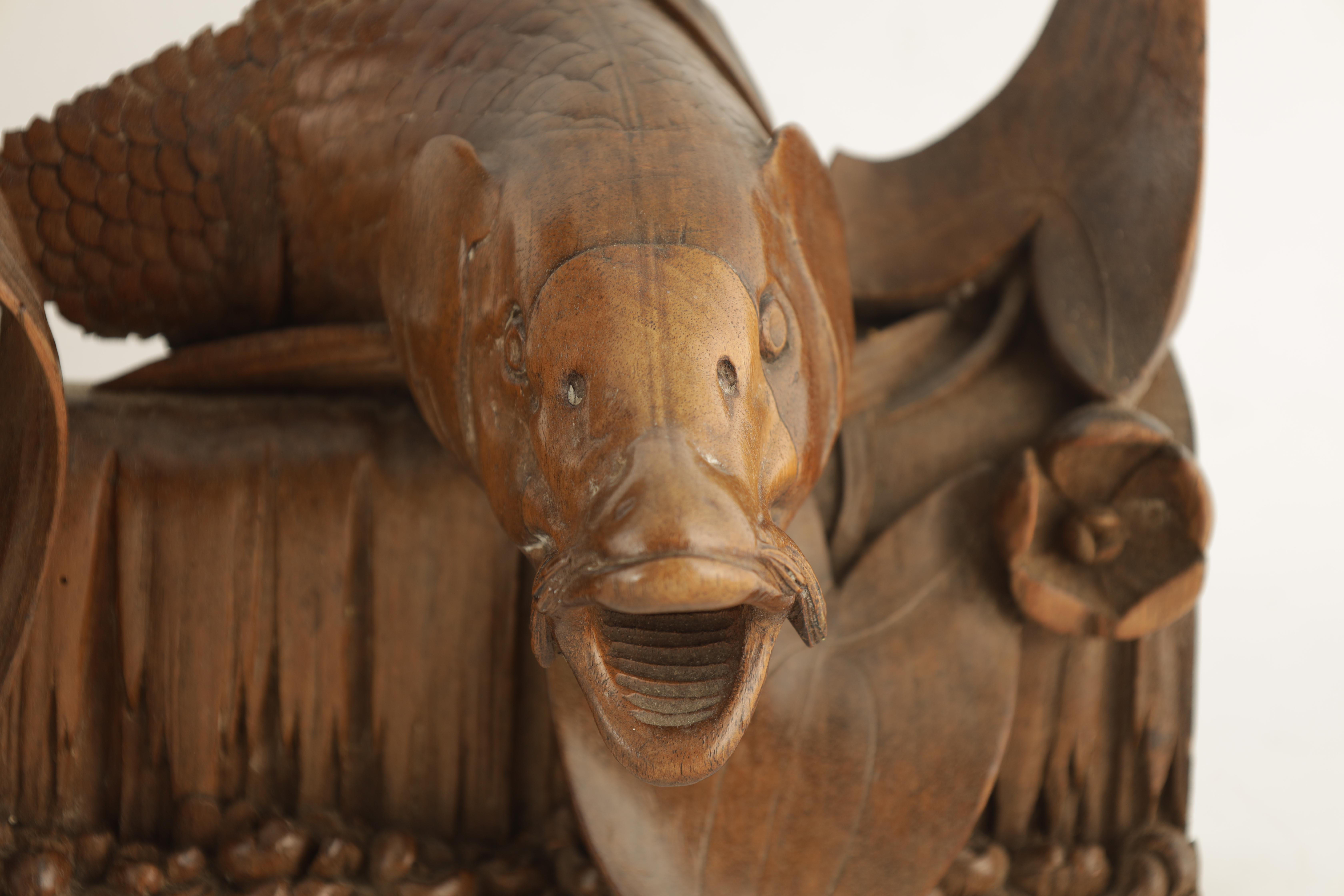 A 19TH CENTURY WALNUT CARVING OF A CARP next to a gadrooned scroll with reeds 49cm wide 38cm high - Image 2 of 6