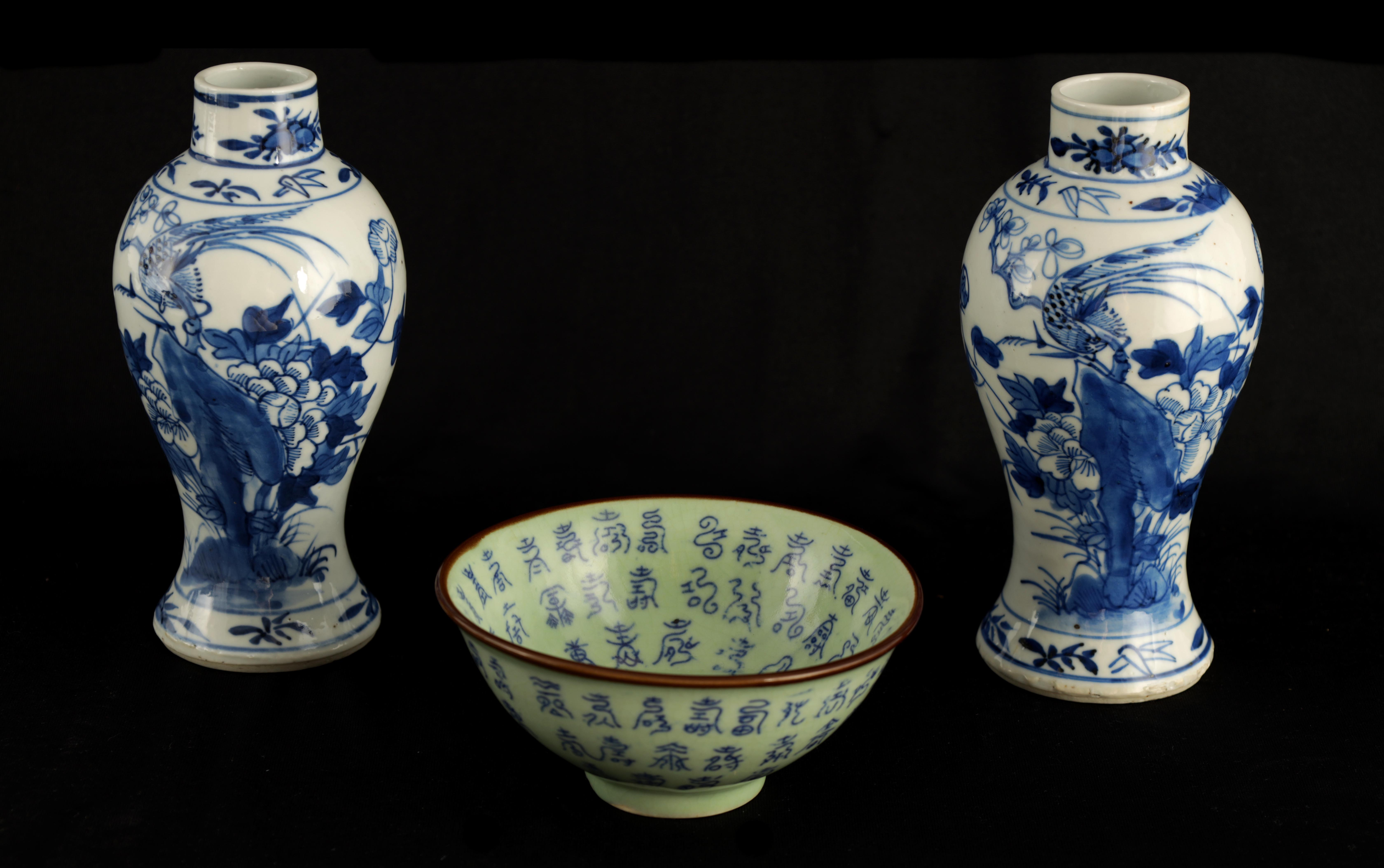A PAIR OF 19TH CENTURY CHINESE BLUE AND WHITE VASES decorated with blossoming trees and birds 17cm