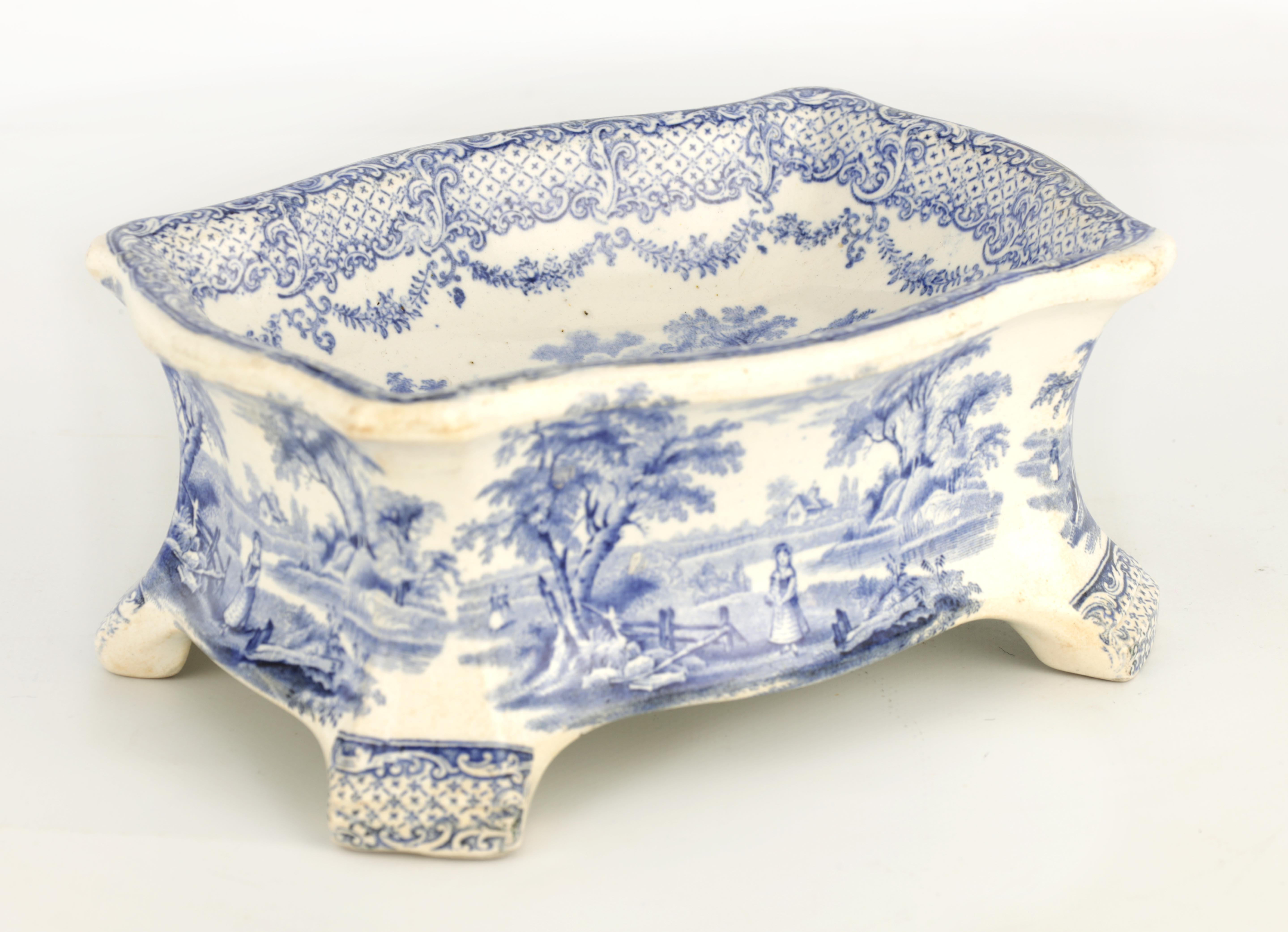 A RARE 19TH CENTURY RIDGWAY BLUE AND WHITE POTTERY DOG BOWL decorated with landscape scenes