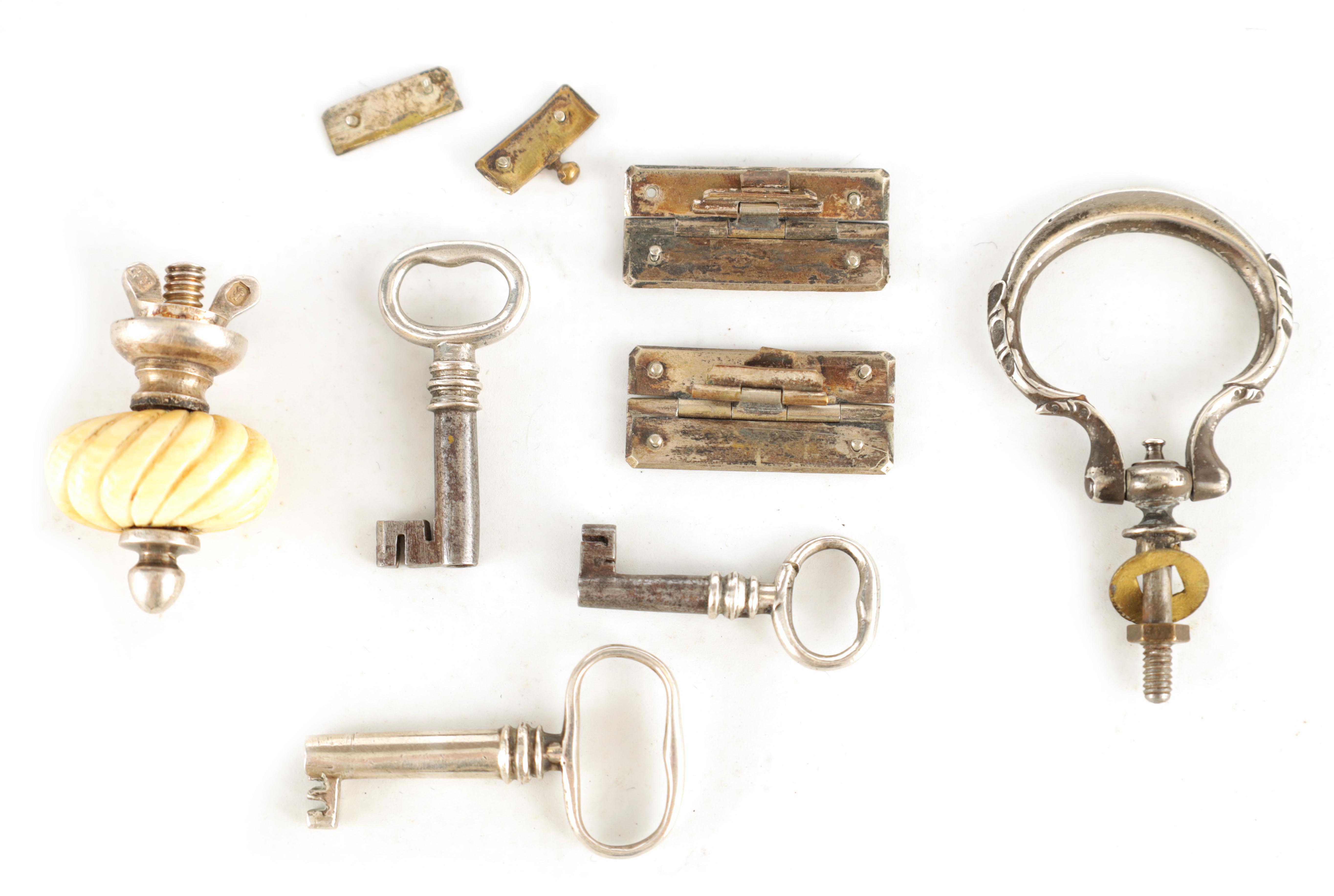 A SELECTION OF SILVER KEYS, FINIALS AND HINGES 7 items in total