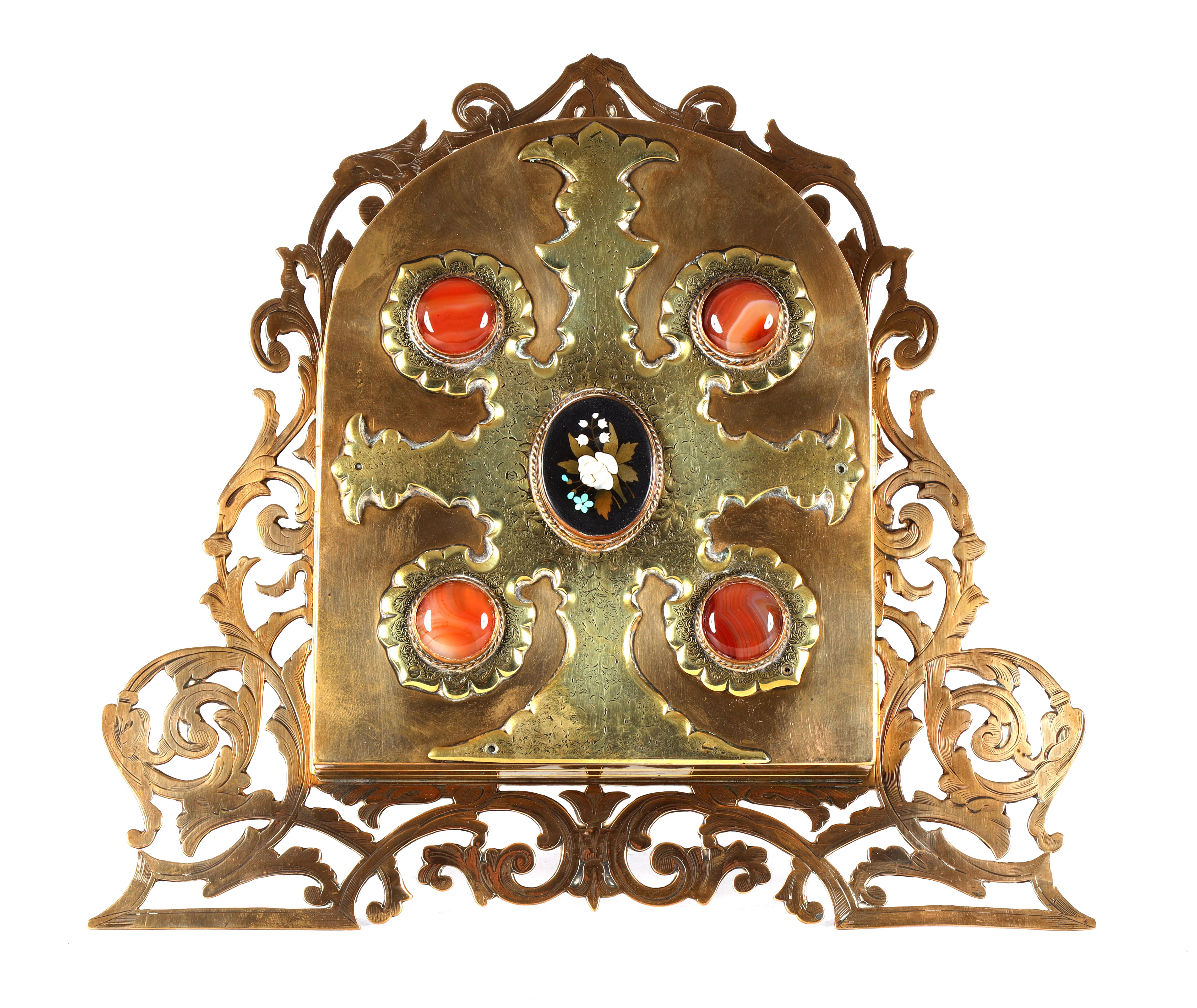 A LATE 19TH CENTURY PIERCED AND ENGRAVED BRONZE FOLDING PHOTOGRAPH FRAME the front with four