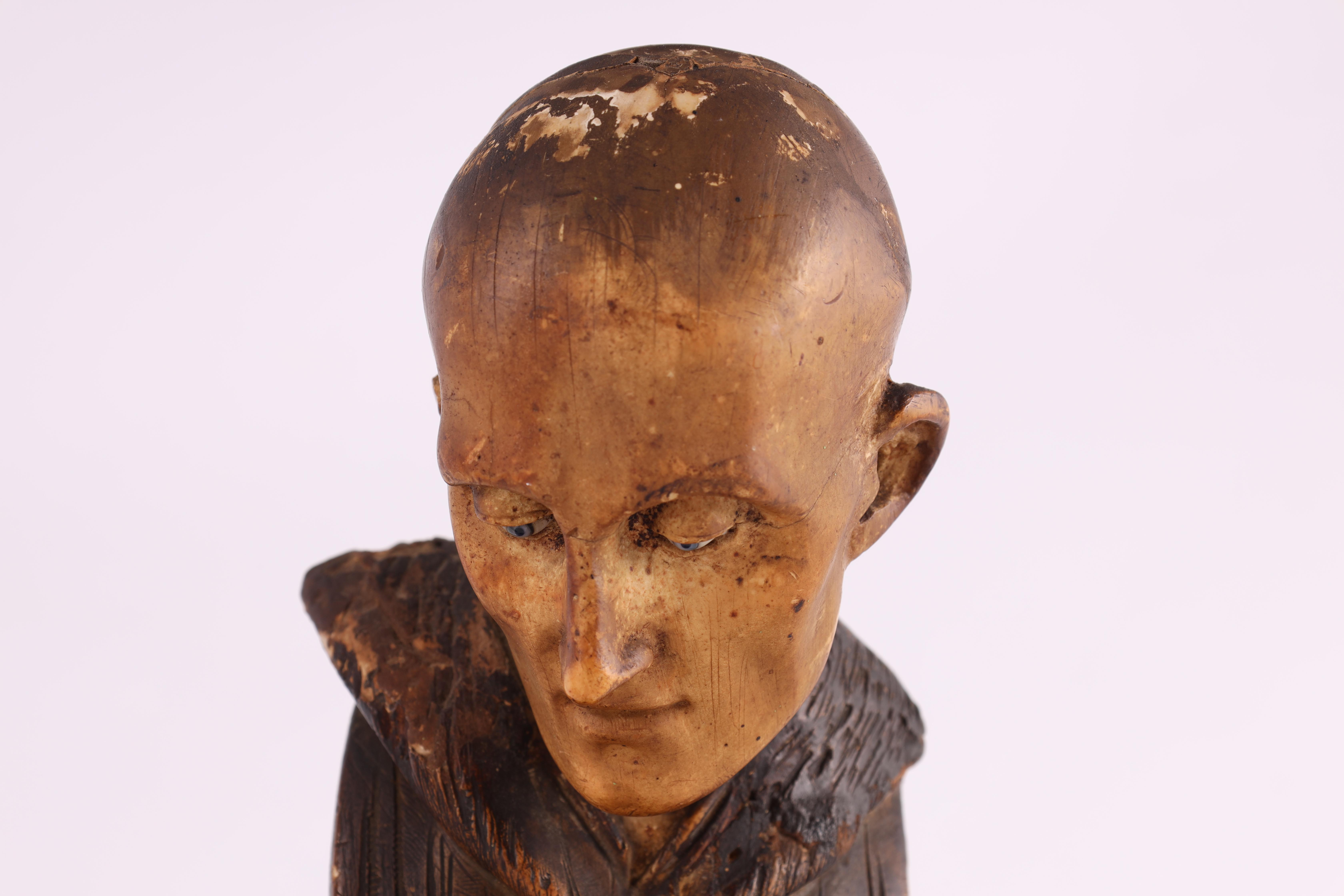 A 19TH CENTURY POLYCHROME PLASTER BUST modelled as a monk with blue eyes mounted on a black marble - Image 3 of 5