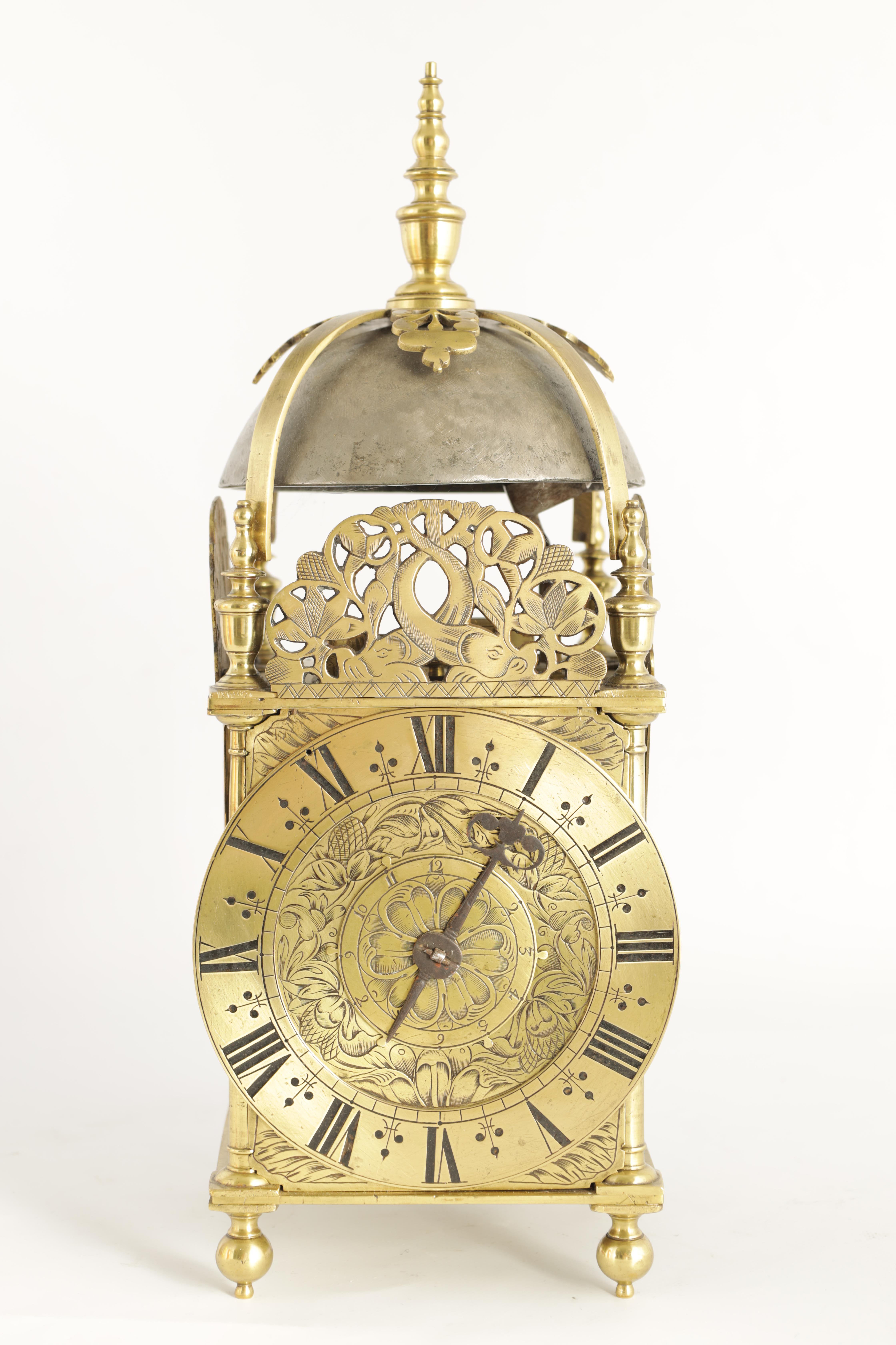 A FINE CHARLES II BRASS LANTERN CLOCKthe posted frame with side doors, engraved fretwork