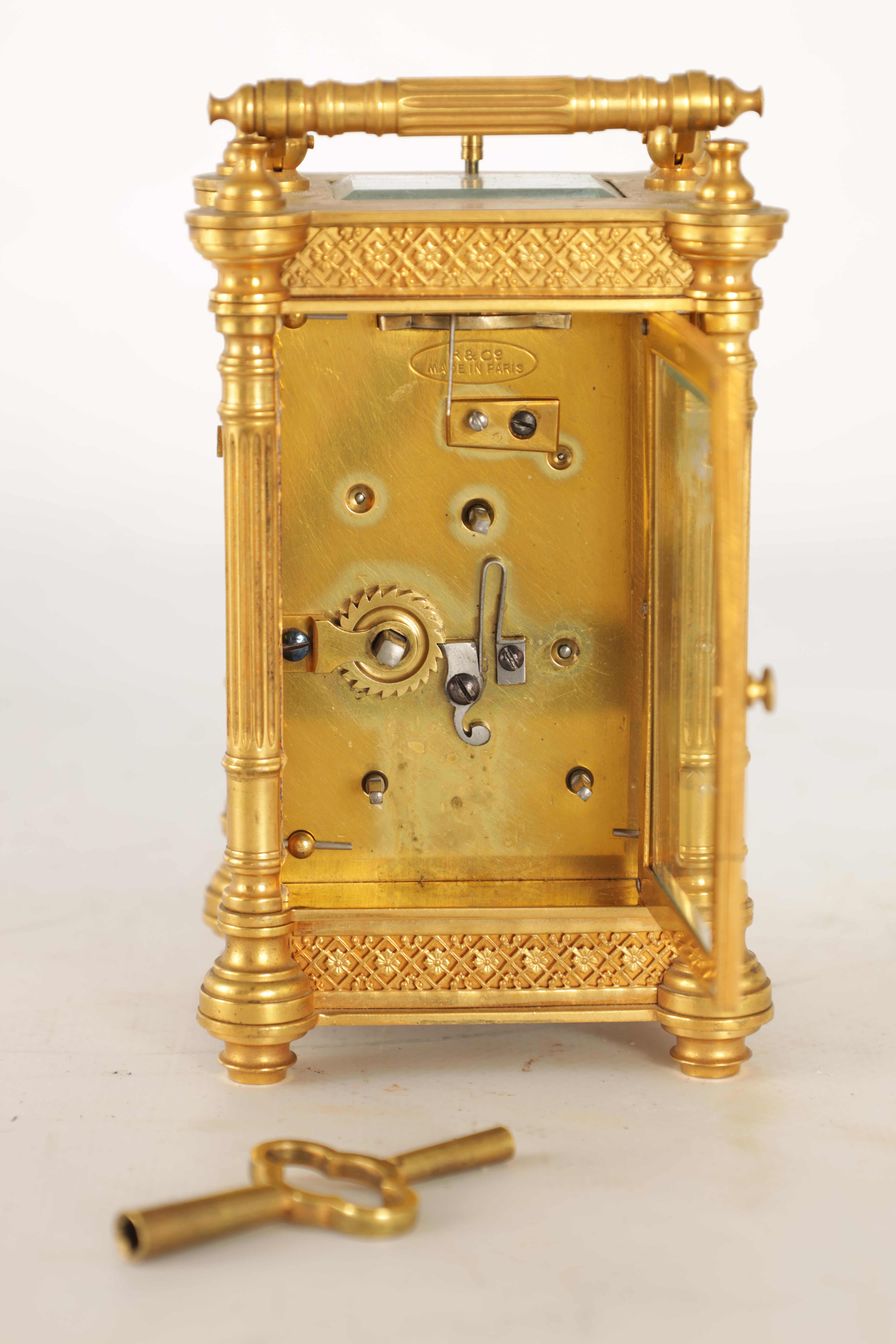 A LATE 19TH CENTURY FRENCH BRASS CARRIAGE CLOCK WITH CALENDAR the gilt case with pierced frieze - Image 5 of 6