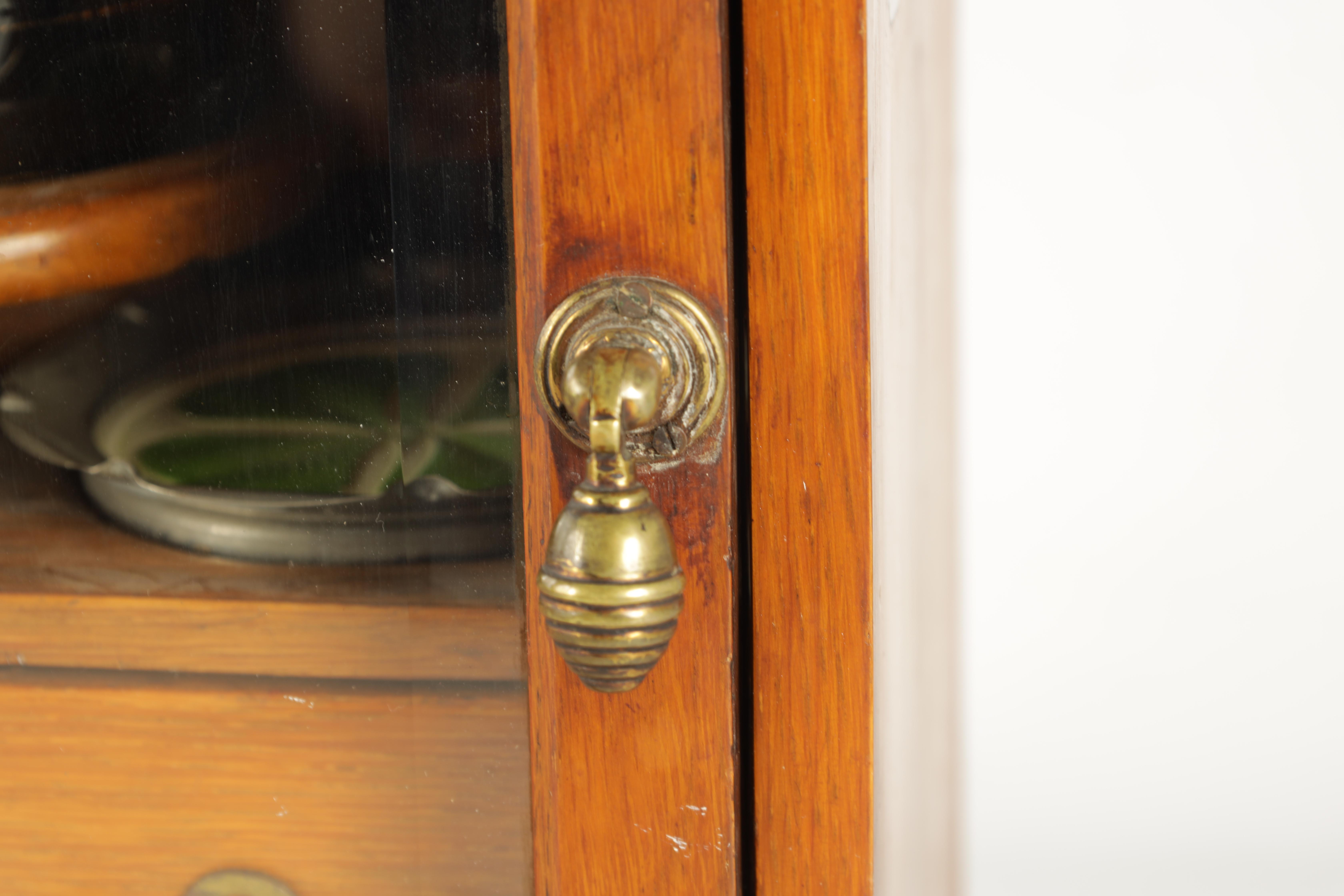 A STYLISH EDWARDIAN OAK SMOKERS CABINET with glazed door enclosing a shelved three drawer interior - Image 3 of 11