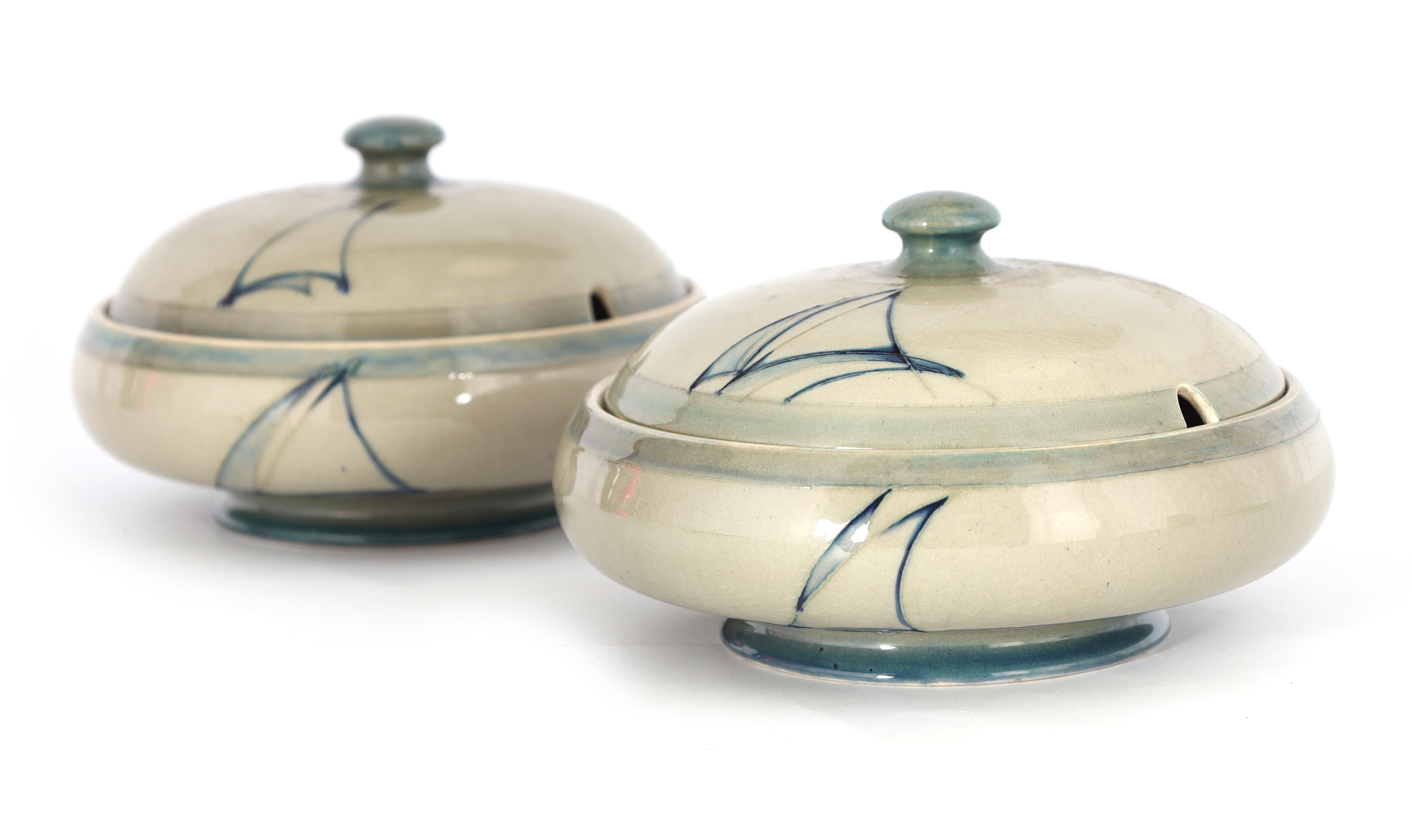 A PAIR OF MOORCROFT LIDDED TABLE TUREENS decorated in the Yacht pattern on a celadon ground, 19.