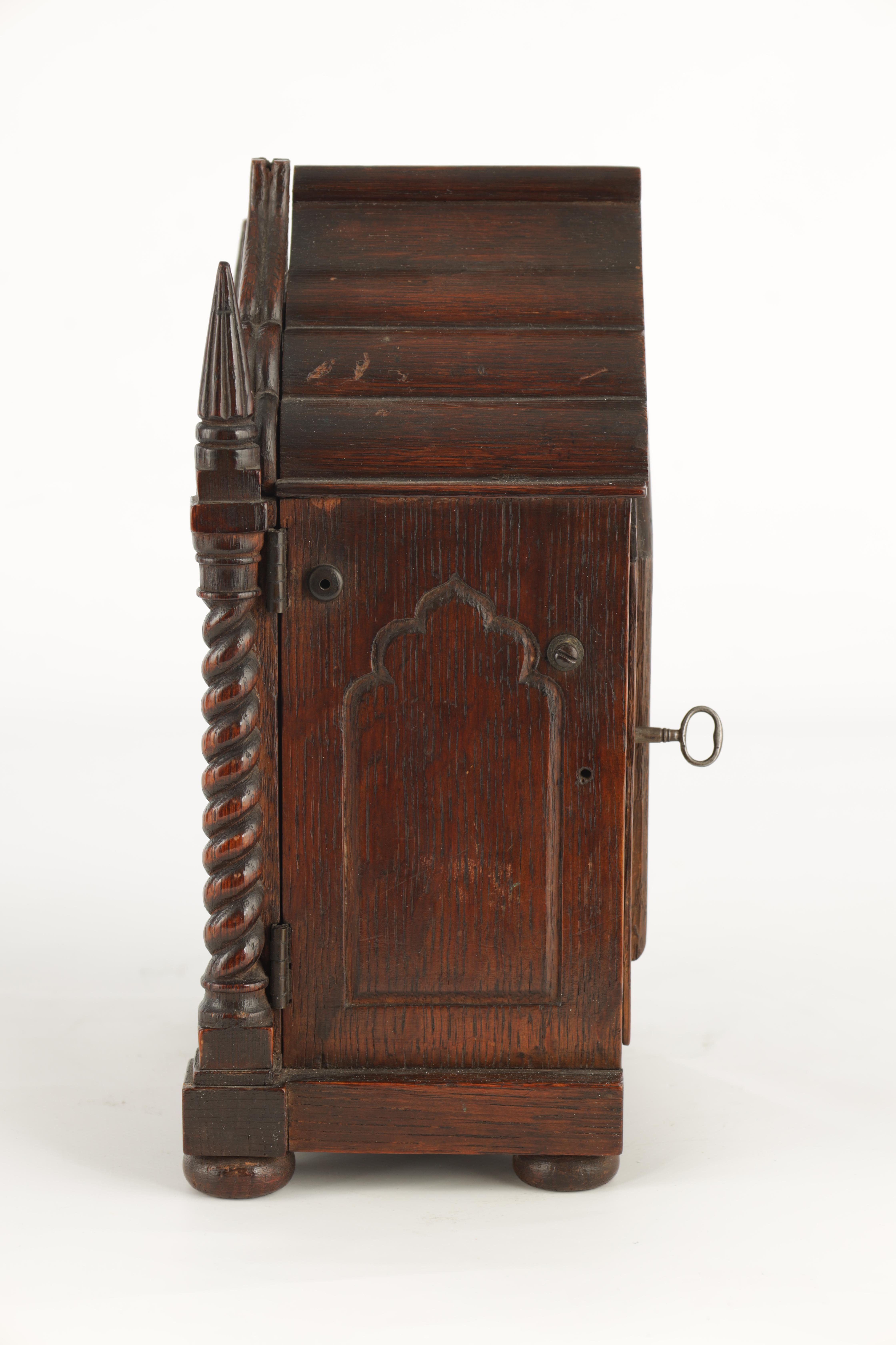 A SMALL MID 19TH CENTURY OAK CASED DOUBLE FUSEE MANTEL CLOCK the gothic style case with twisted - Image 6 of 7