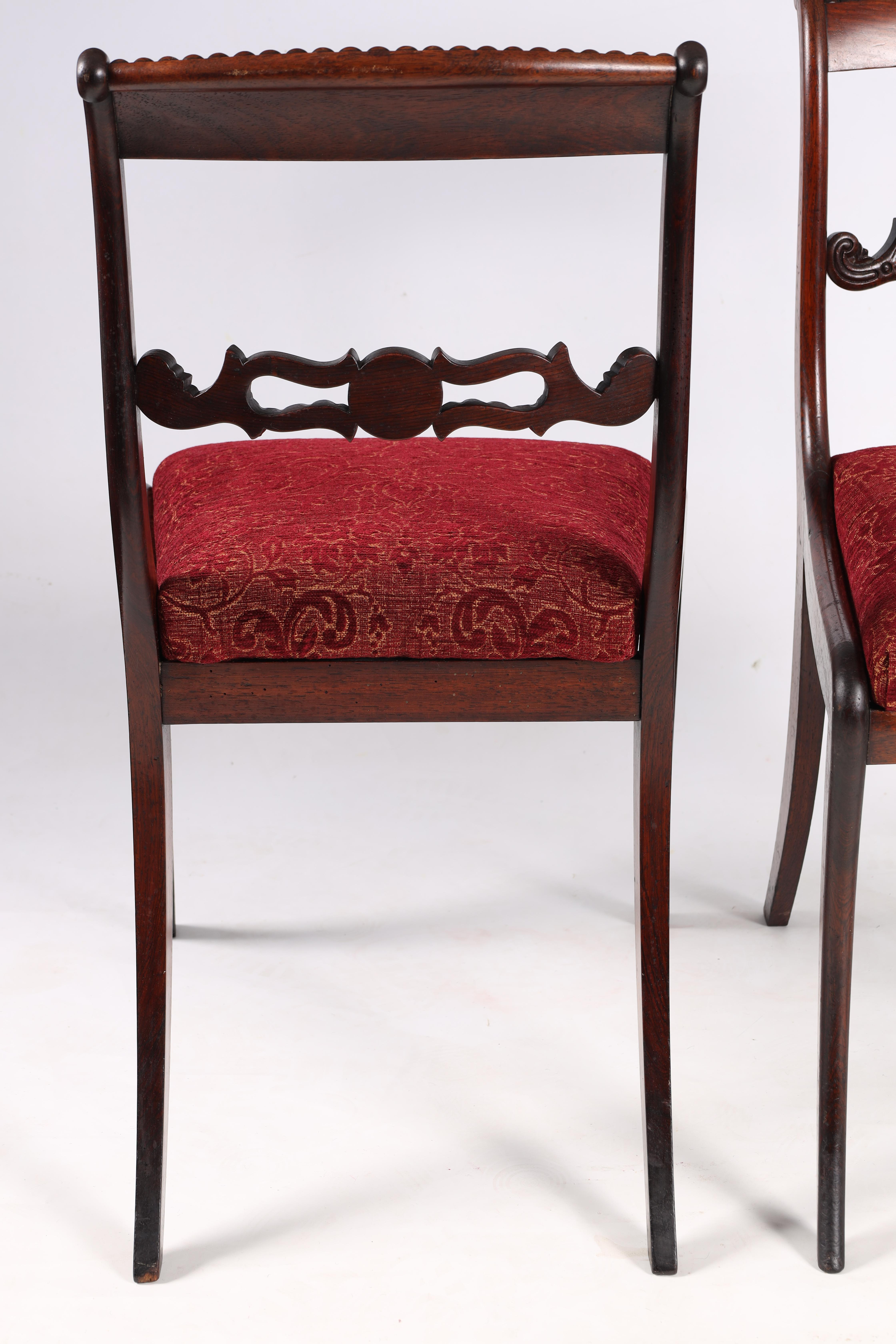 A SET OF EIGHT REGENCY ROSEWOOD DINING CHAIRS having gadrooned back splats and carved stretchers, - Image 4 of 8