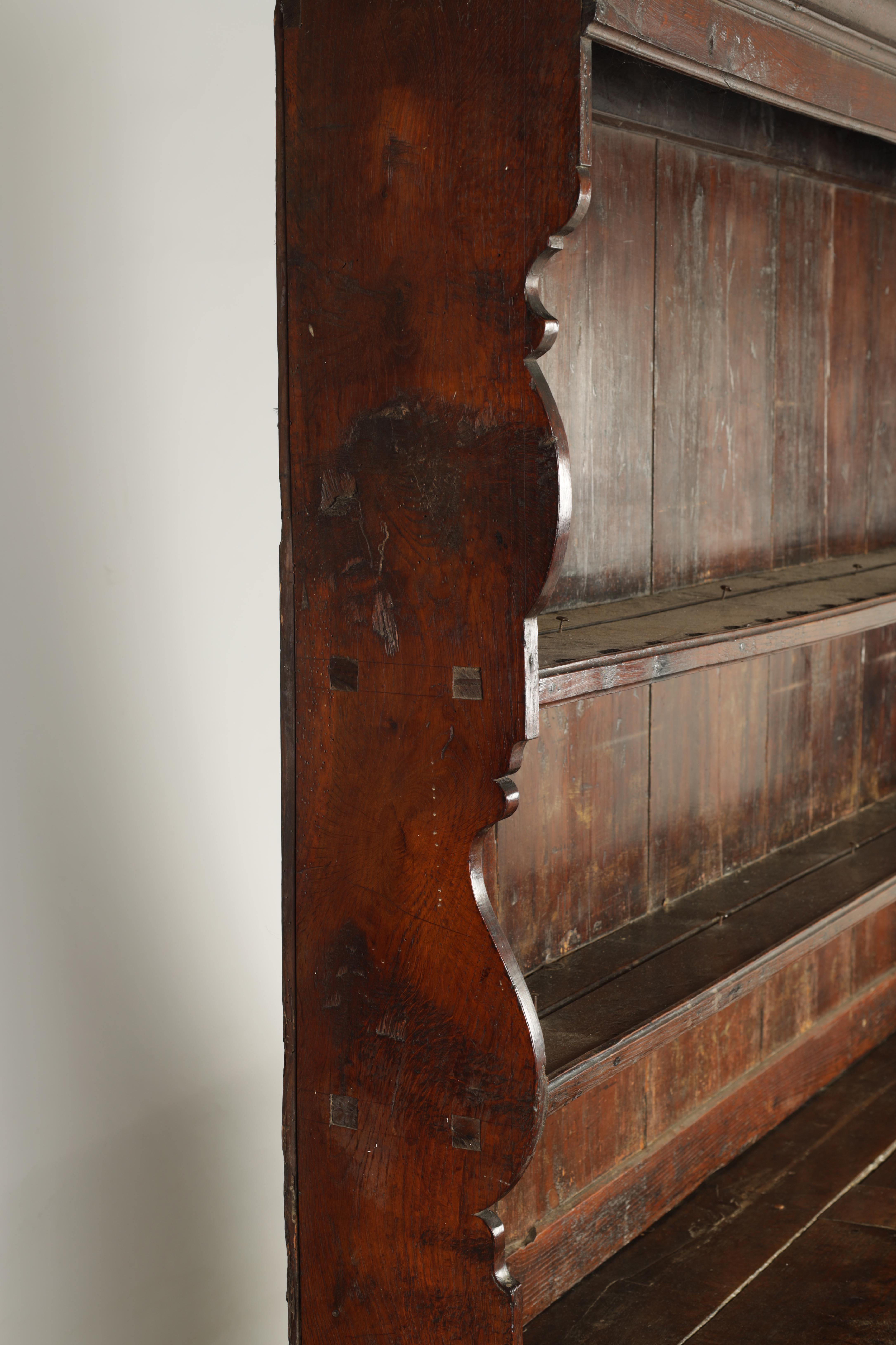AN EARLY 18TH CENTURY SILHOUETTE LEG OAK DRESSER AND RACK with shaped moulded rack fitted two - Image 8 of 10