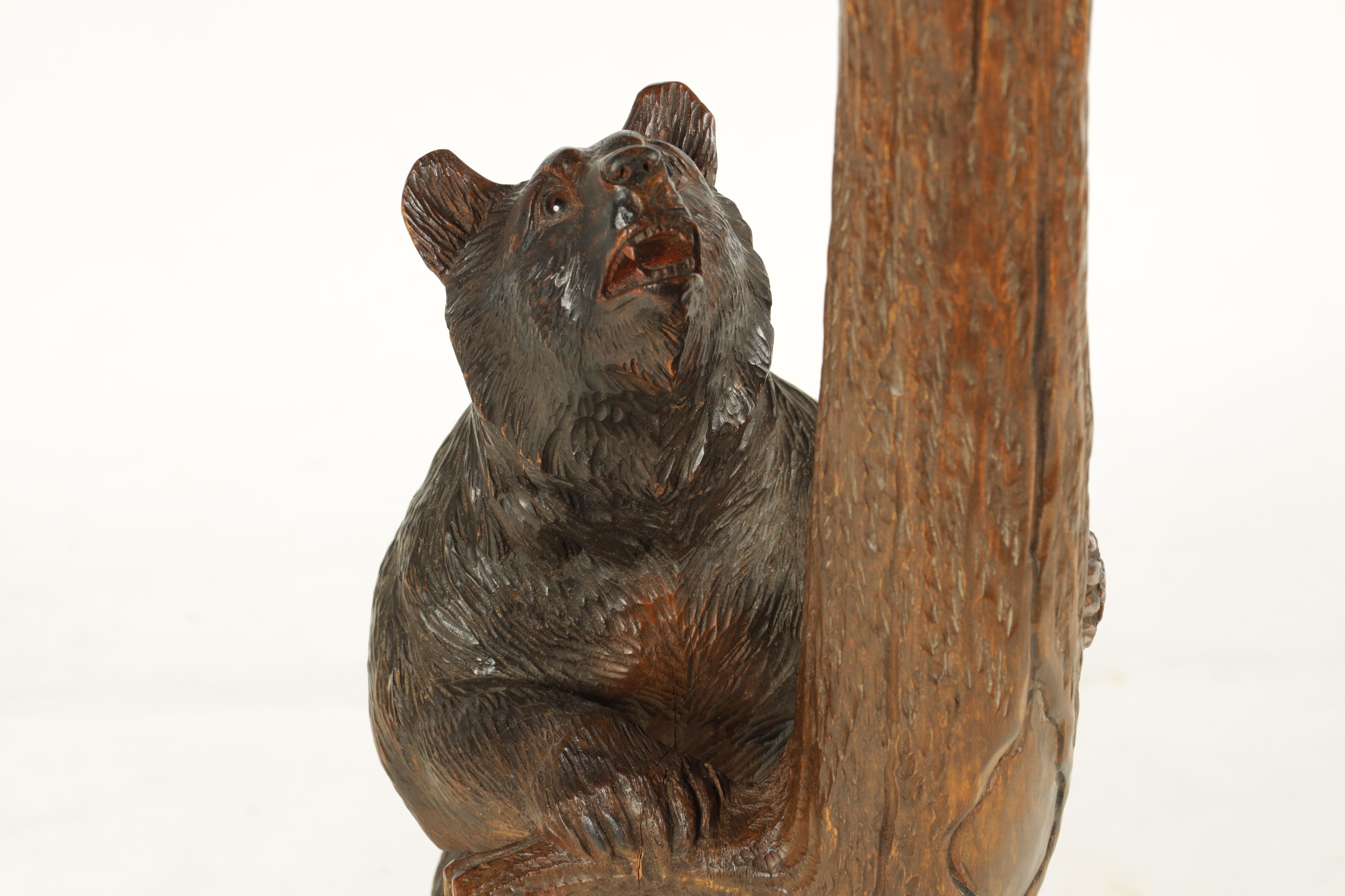 A LATE 19TH CENTURY SWISS CARVED BLACK FOREST SMOKERS TABLE with leaf carved top having two bear - Image 4 of 9