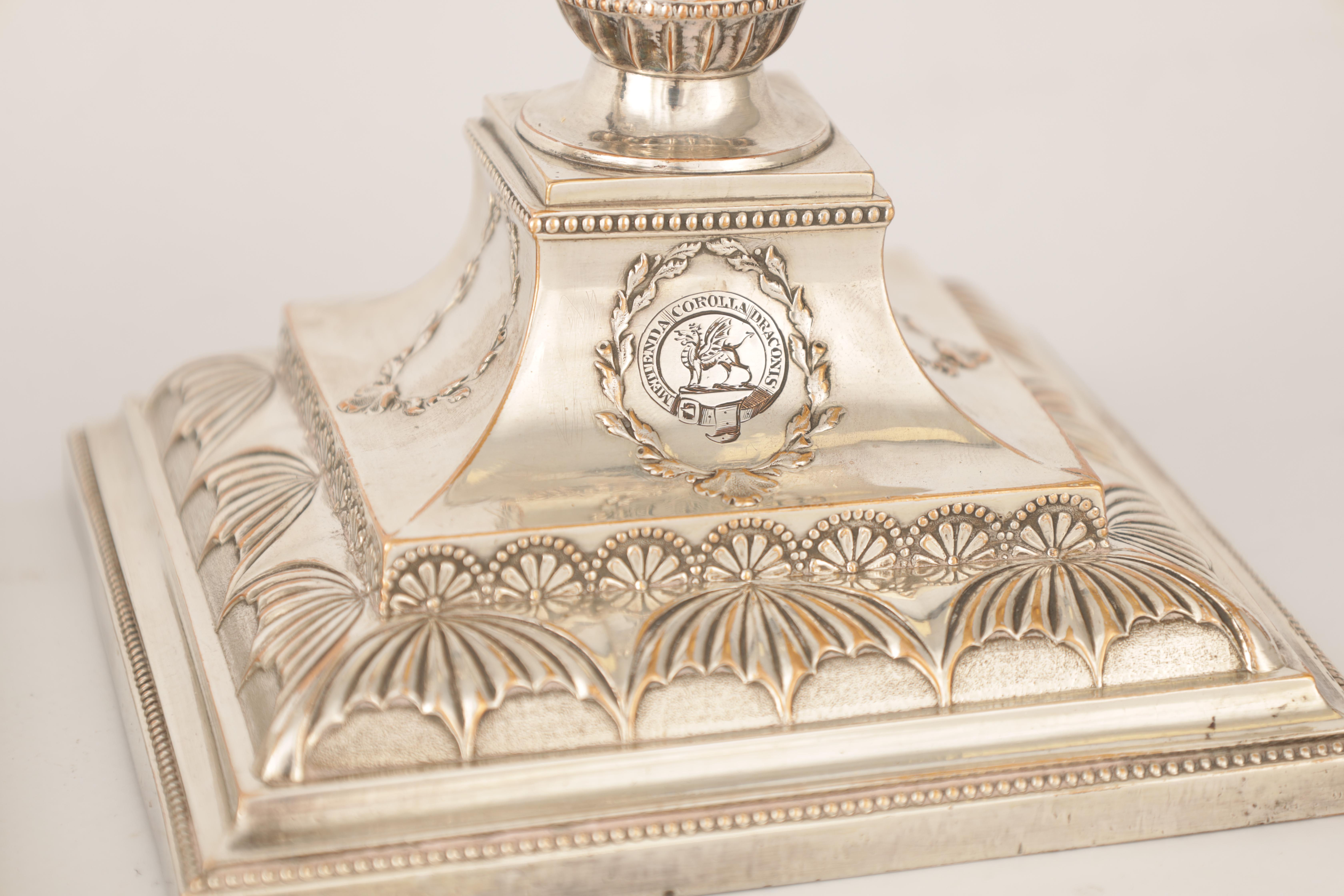 A PAIR OF 19TH CENTURY SHEFFIELD PLATE SILVER ON COPPER ADAM STYLE CANDLESTICKS bearing the crest - Image 4 of 5