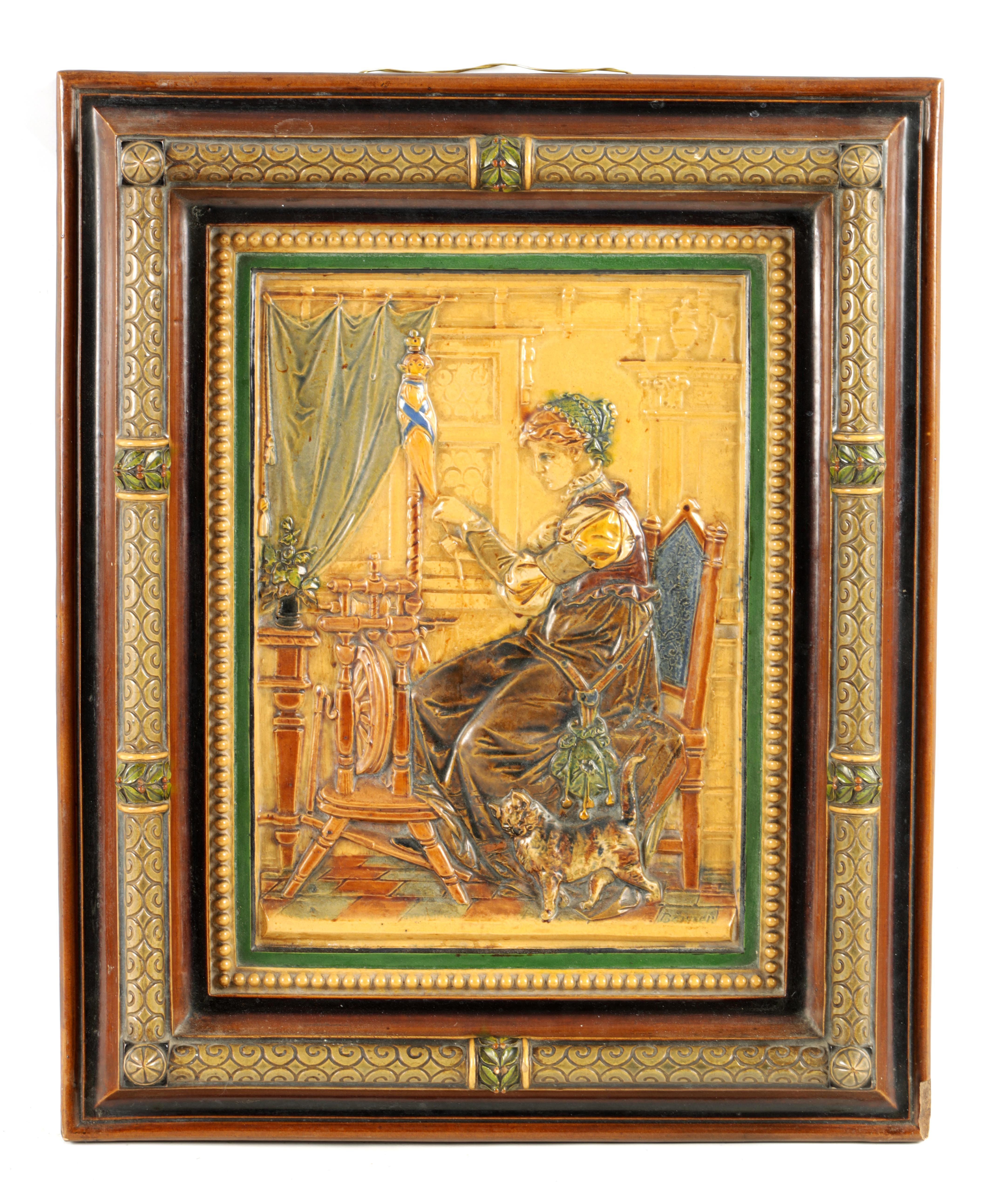 A 19TH CENTURY BORNER & BICHWEILER FIGURAL MAJOLICA HANGING PLAQUE decorated in polychrome colours -