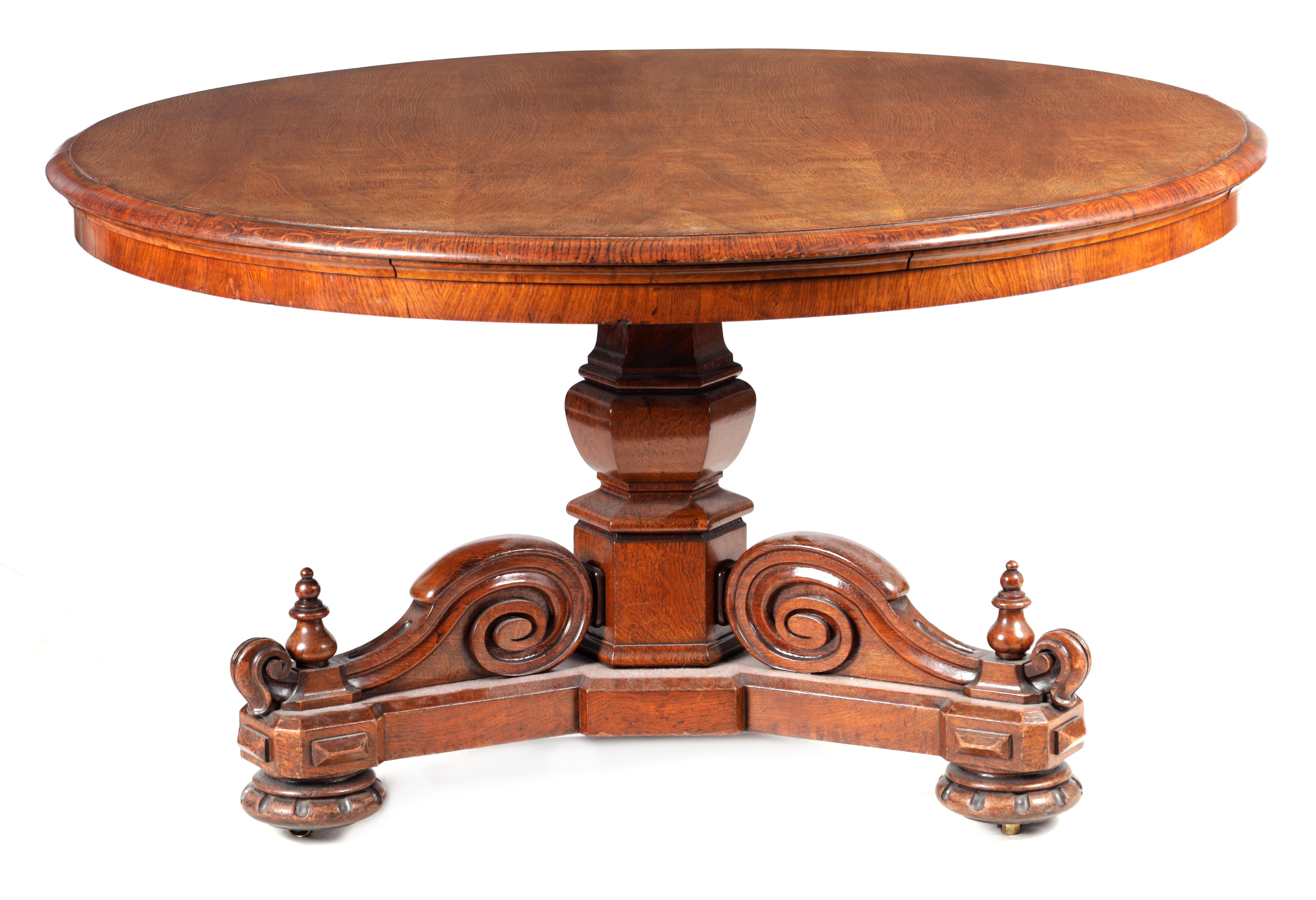 A 19TH CENTURY POLLARD OAK CENTRE TABLE with circular moulded edge above a hexagonal base with