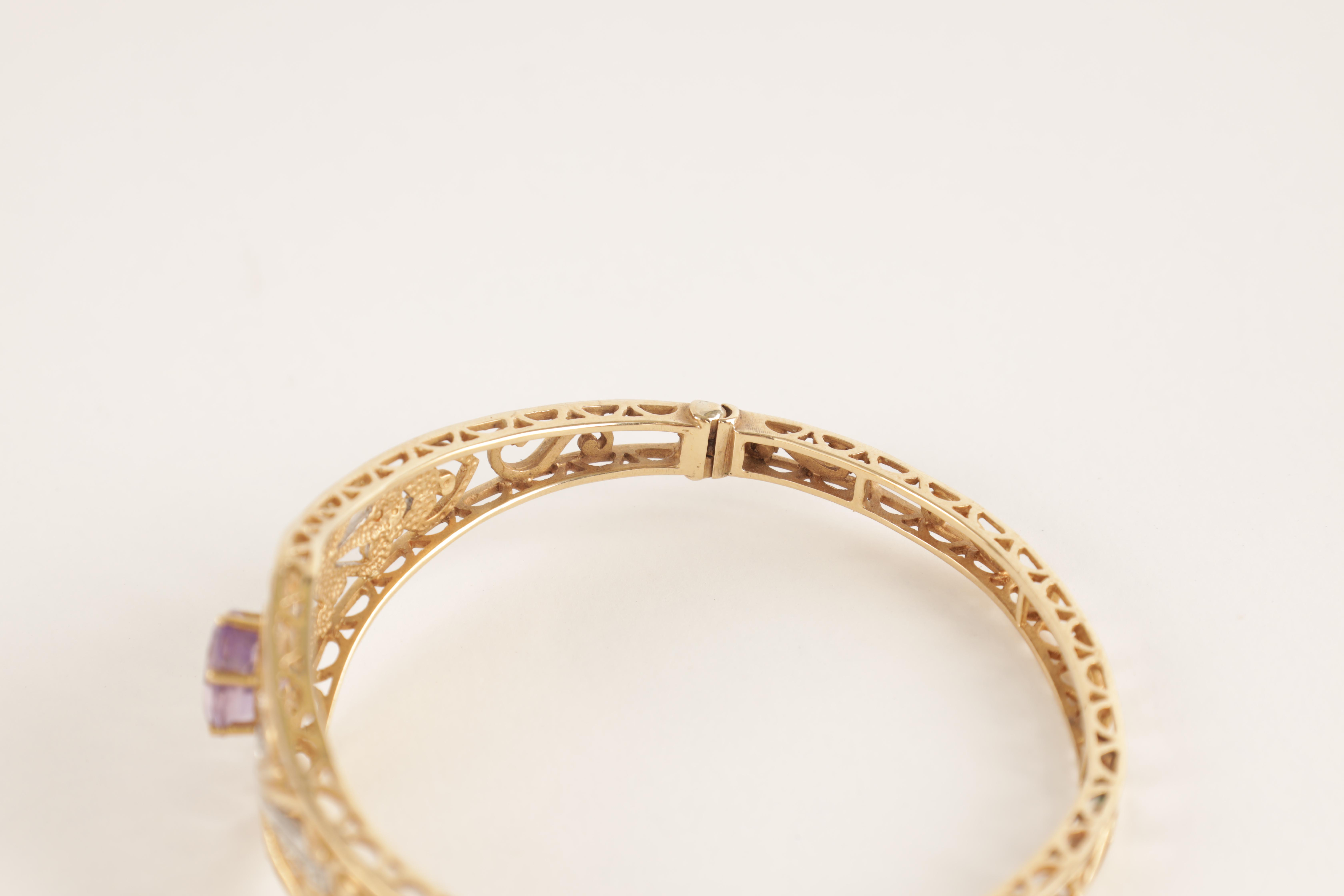 A LADIES 9CT GOLD DIAMOND AND AMETHYST BANGLE having filigree scrollwork decoration with diamonds - Image 3 of 4
