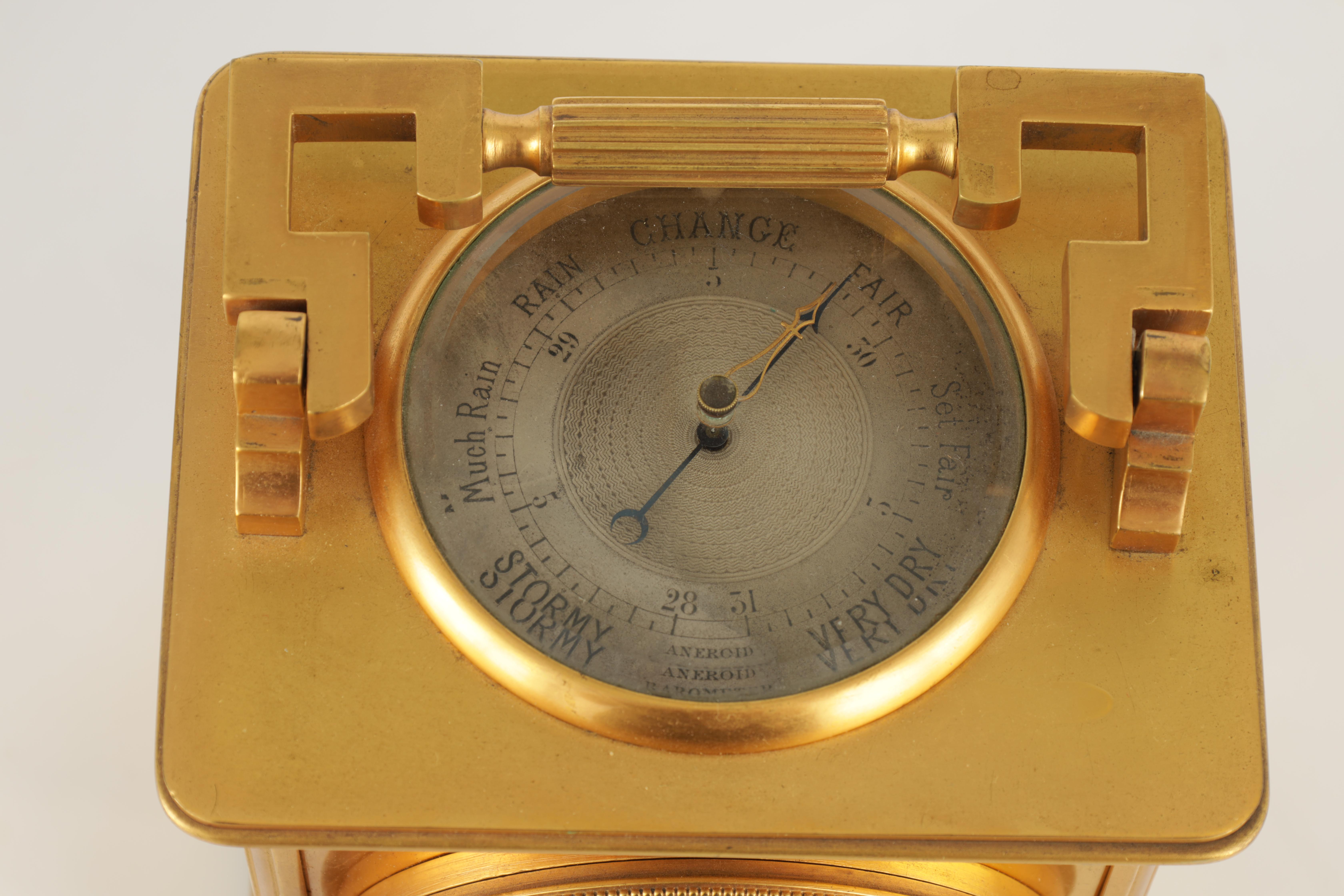 A LARGE FRENCH GILT BRASS CARRIAGE CLOCK WITH BAROMETER the moulded case with hinged handle, the top - Image 4 of 8
