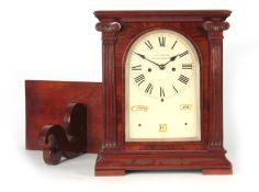 GEORGE TAYLOR, WOLVERHAMPTON A RARE FIGURED MAHOGANY PERPETUAL CALENDAR BRACKET CLOCK ON BRACKET the